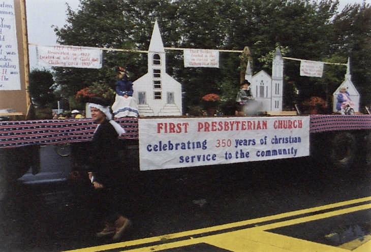 Presbyterian Church float, showing 1717, 1860, and 1960 church exteriors