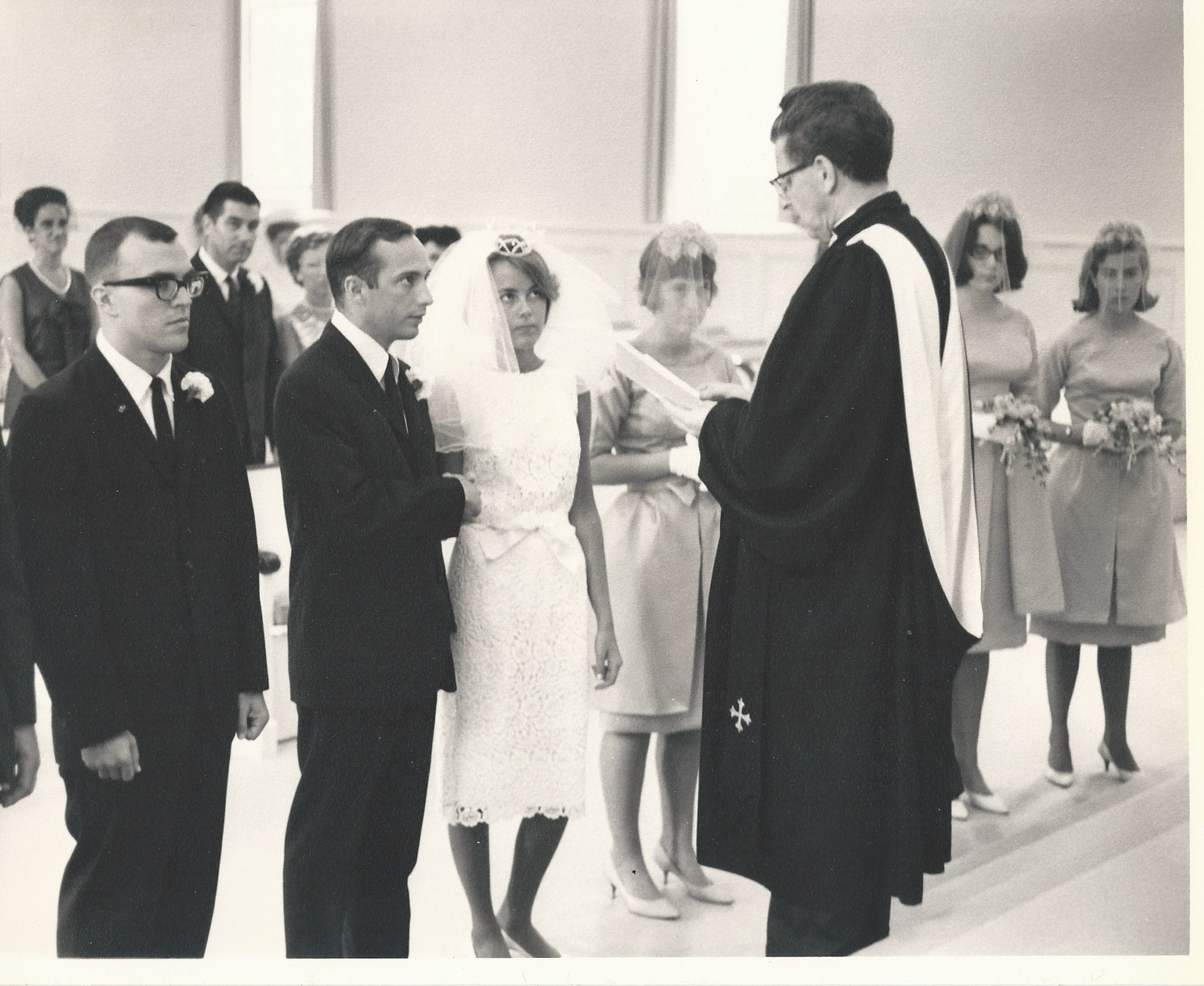 Rev. Renton officiating the marriage of Stewart and Gay Harkness Quarty in 1964