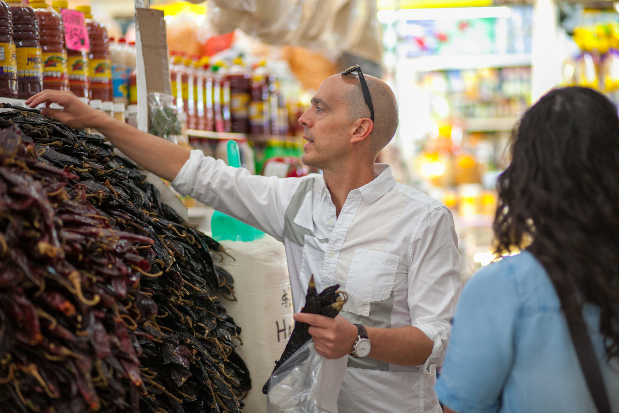 shopping for chilis at a market in Mexico City