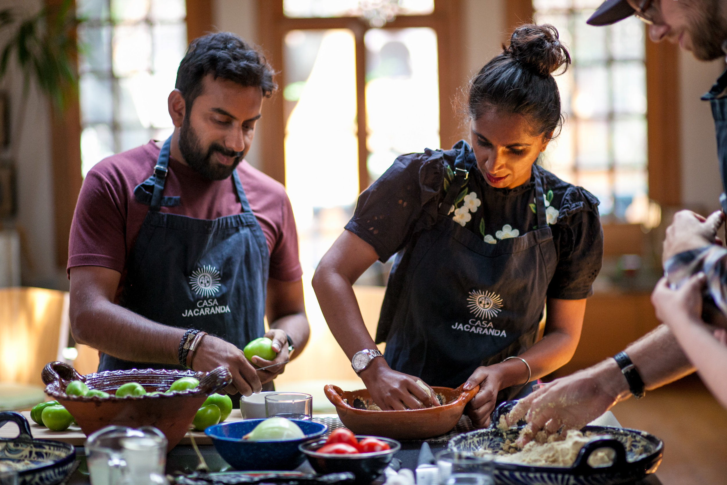 couple making Mexican food in a cooking class