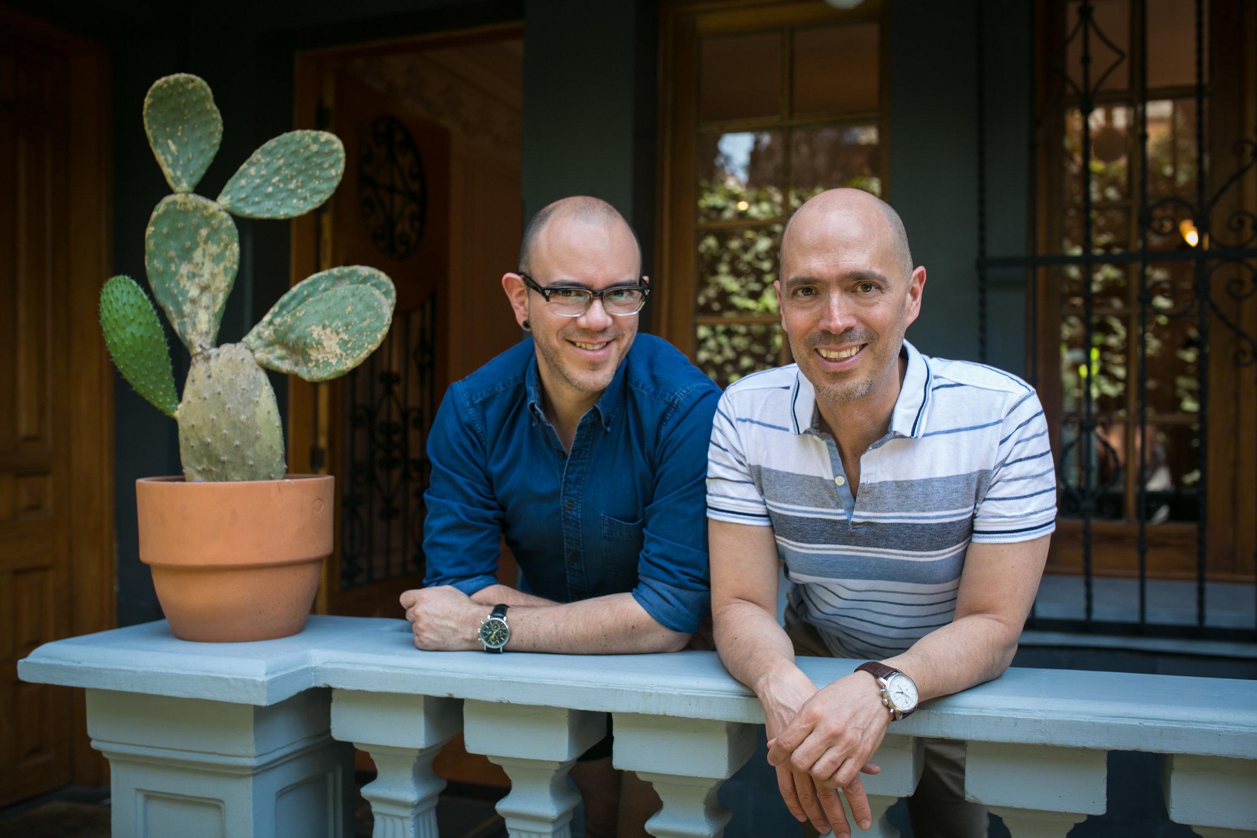 Jorge Fitz and Alberto Estua pose in front of Casa Jacaranda