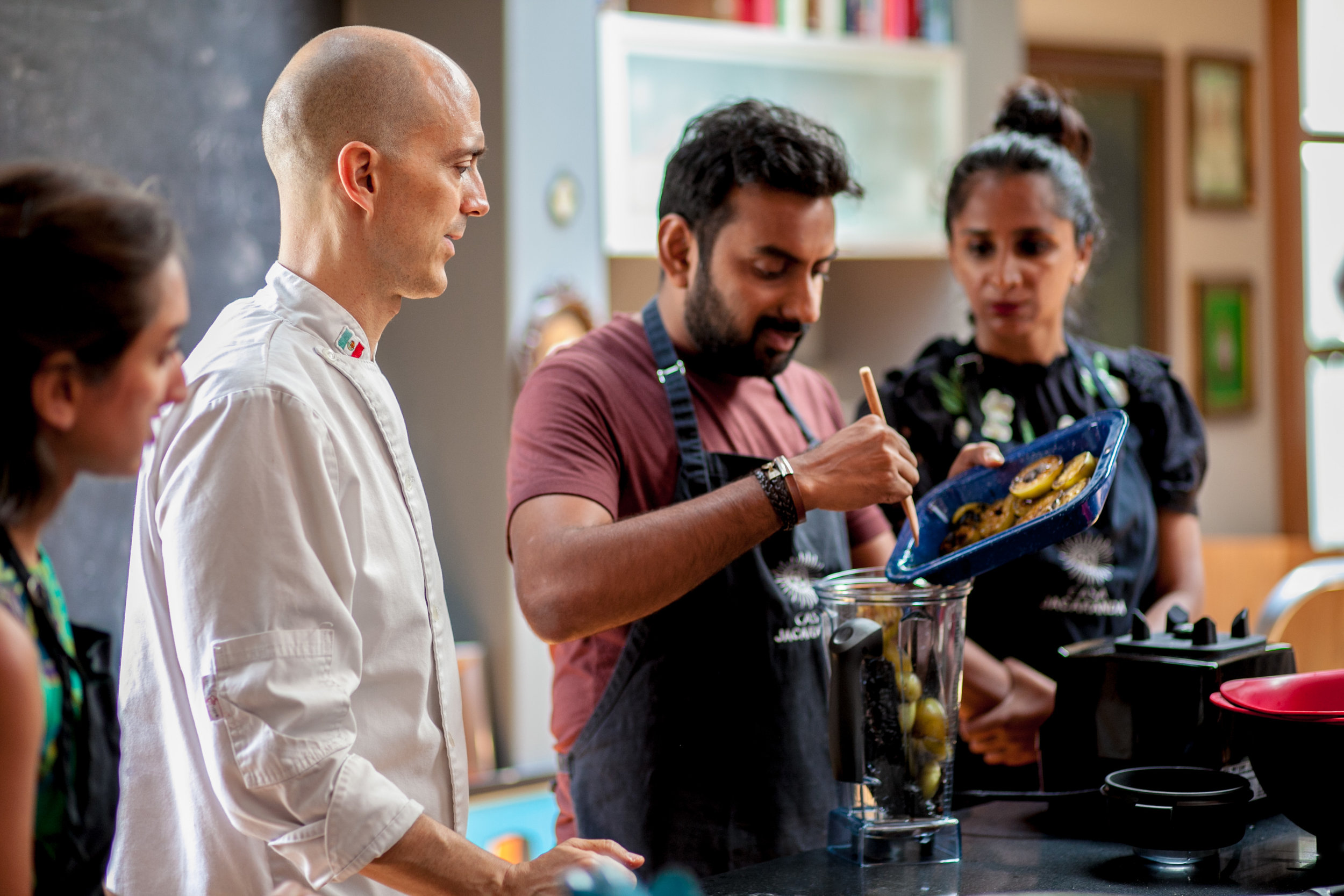 Copy of students using the blender in a Mexican cooking class