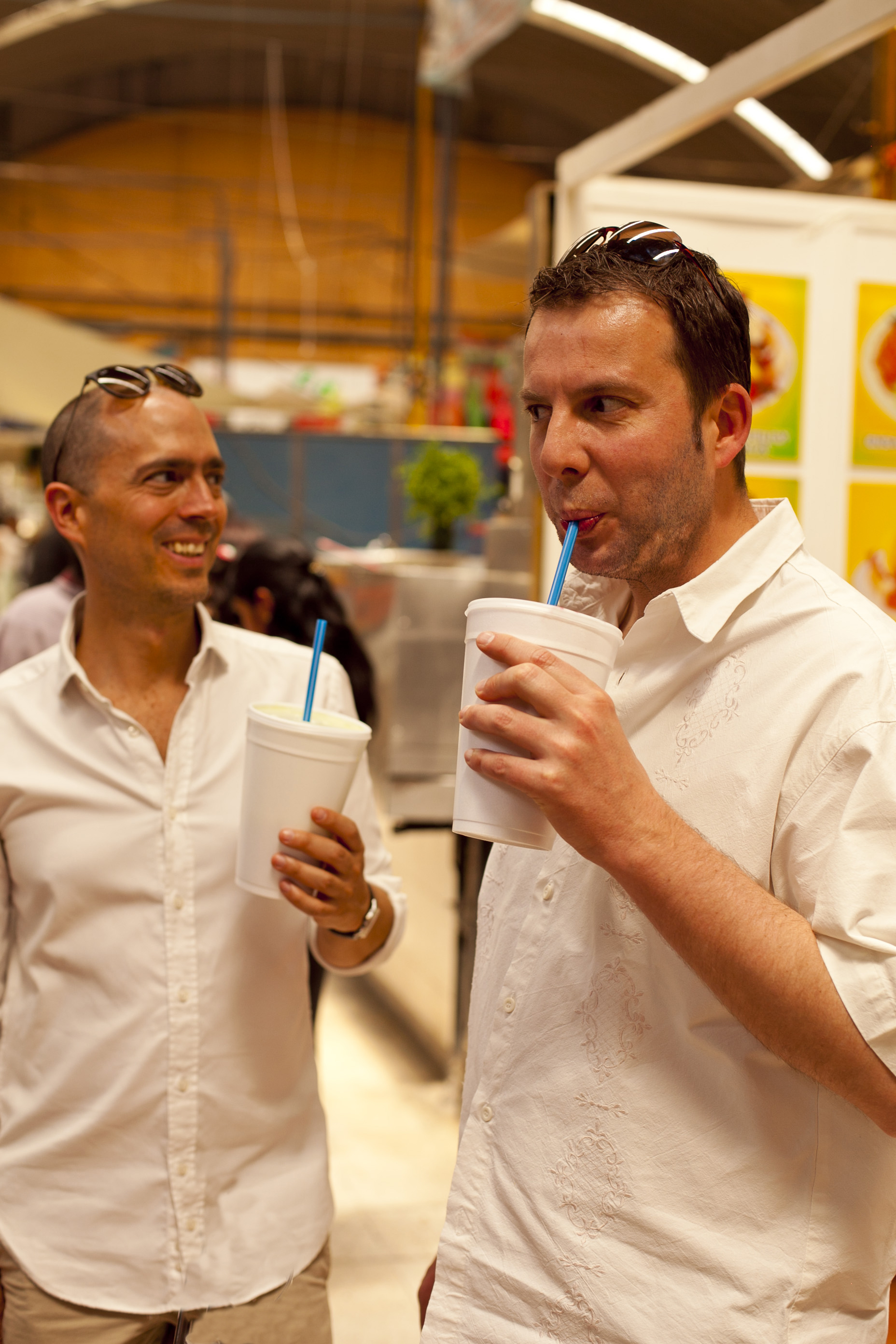 men drinking fresh juice at a Mexico City market