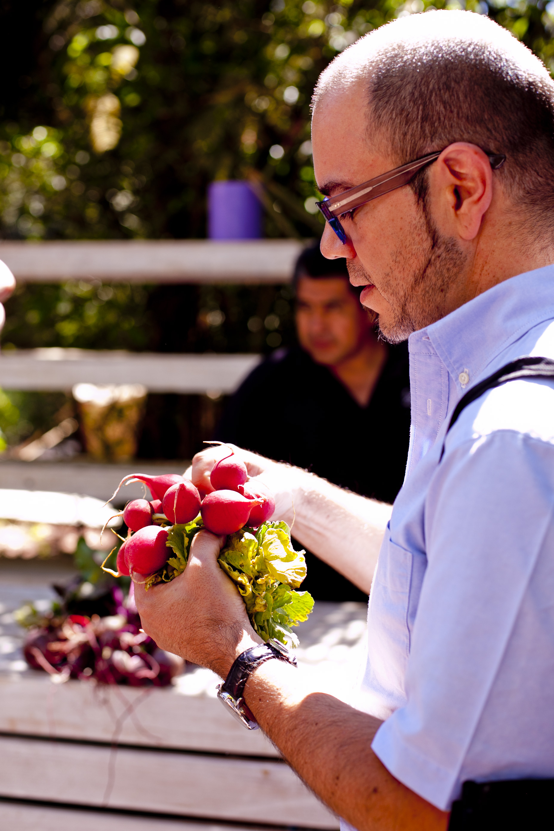 man holding bunch of beet roots in Mexico City