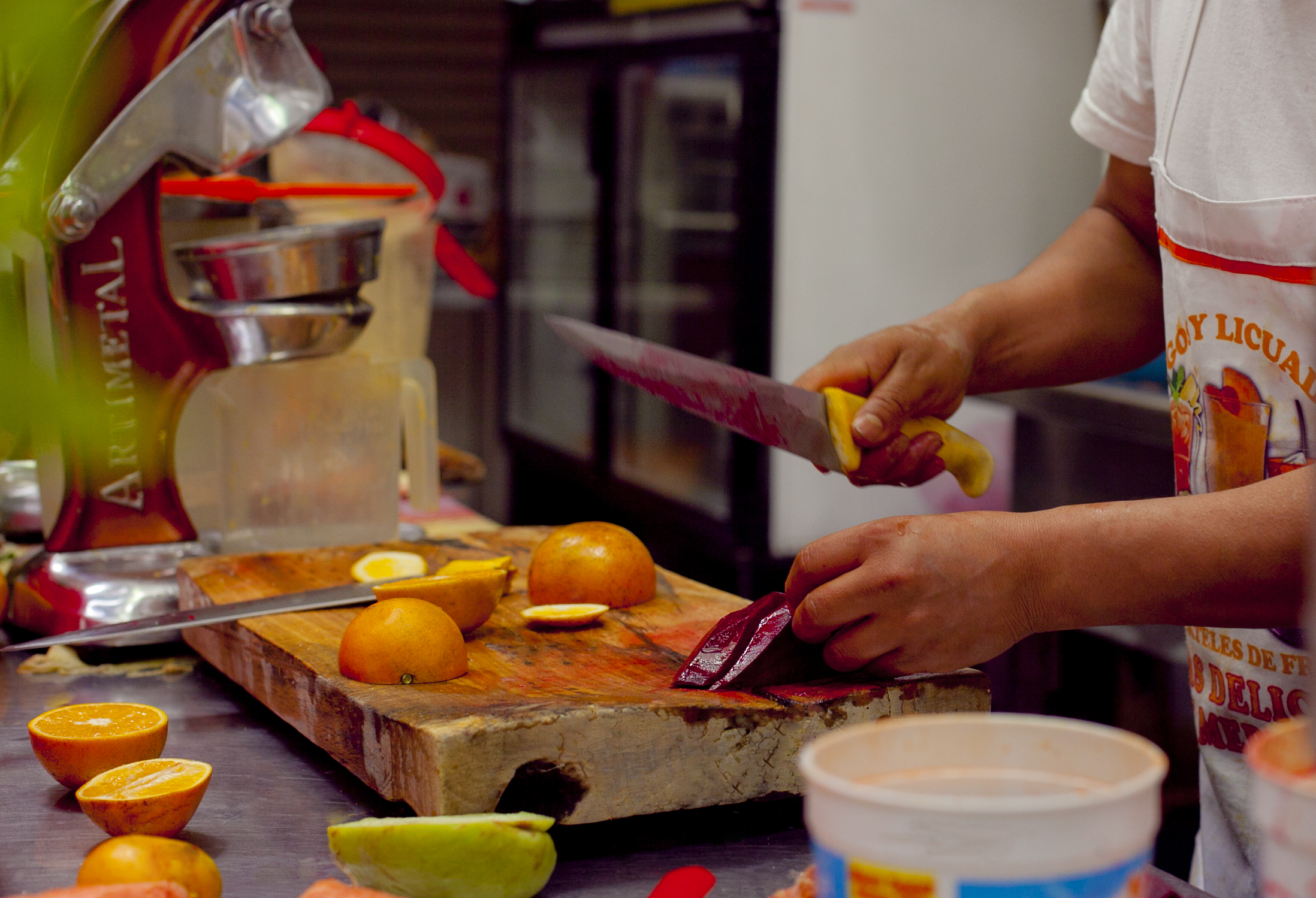 Chopping fruit at a market in Mexico City.
