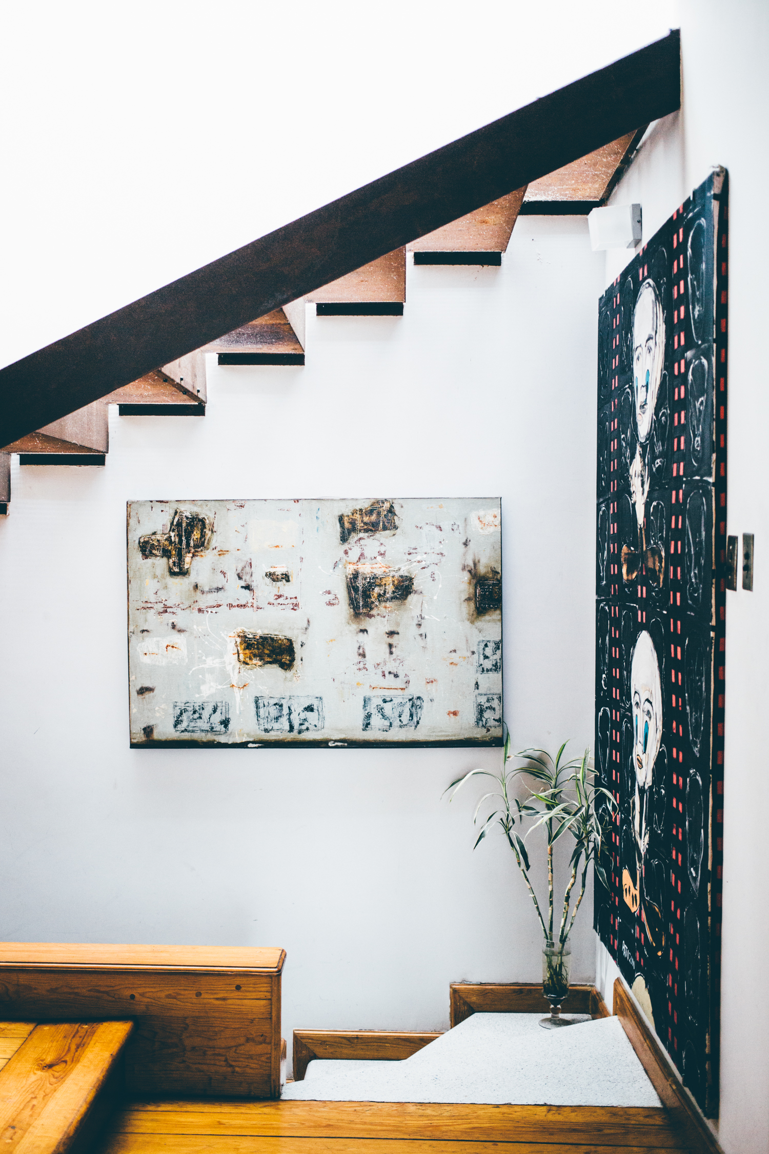 Interior staircase and wall art.
