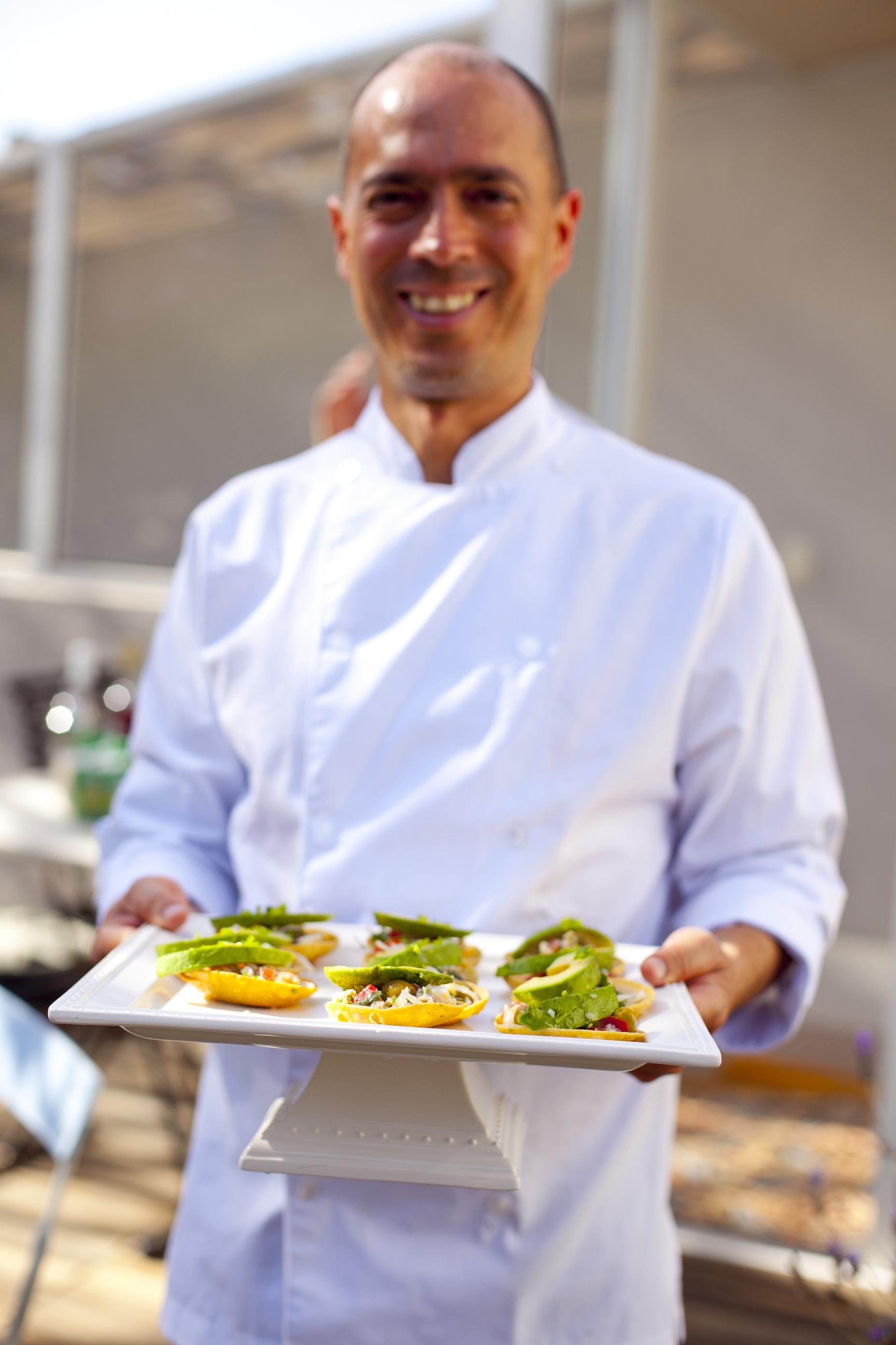 man serving Ceviche Tostadas