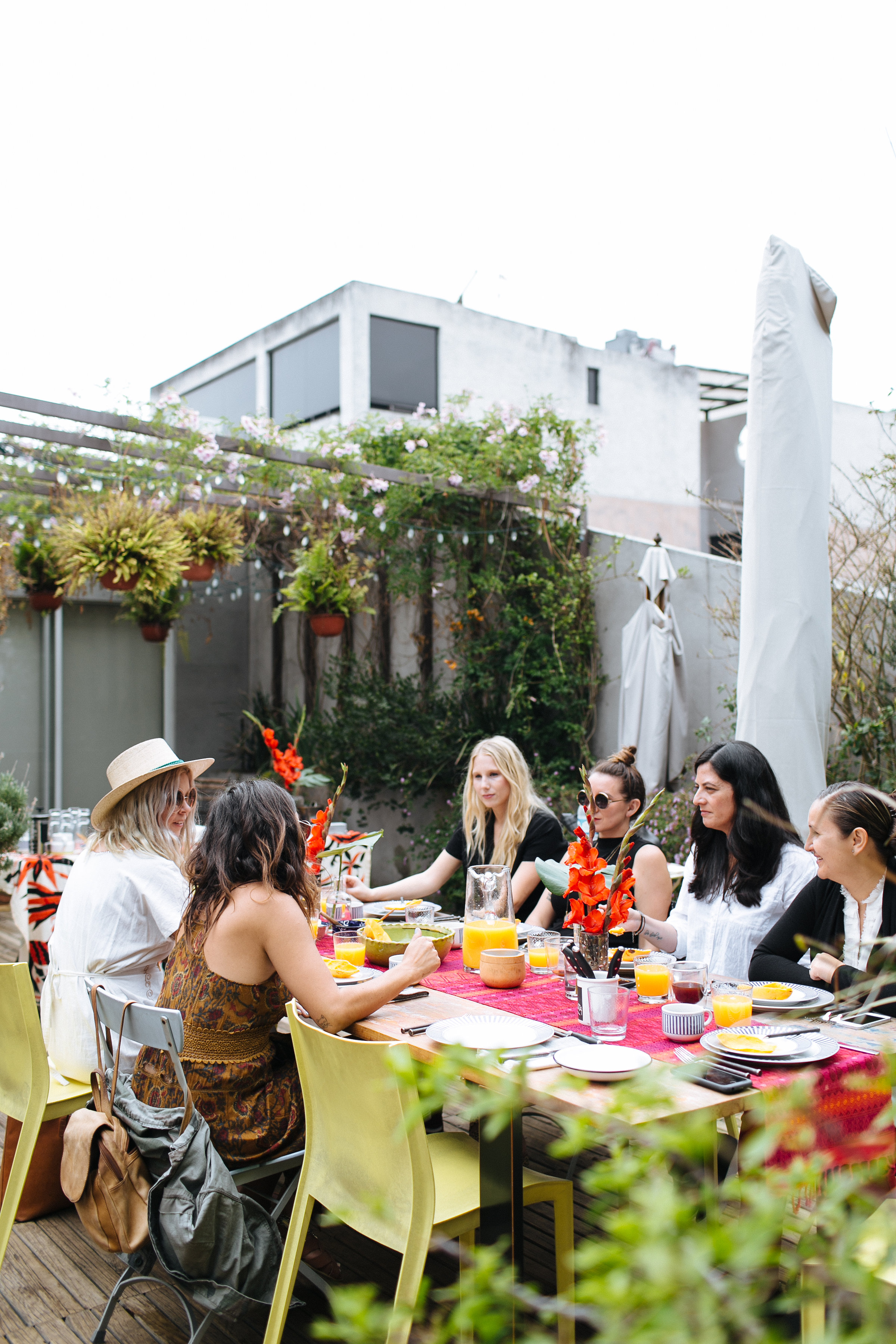 Five women eating Mexican Food on the rooftop.