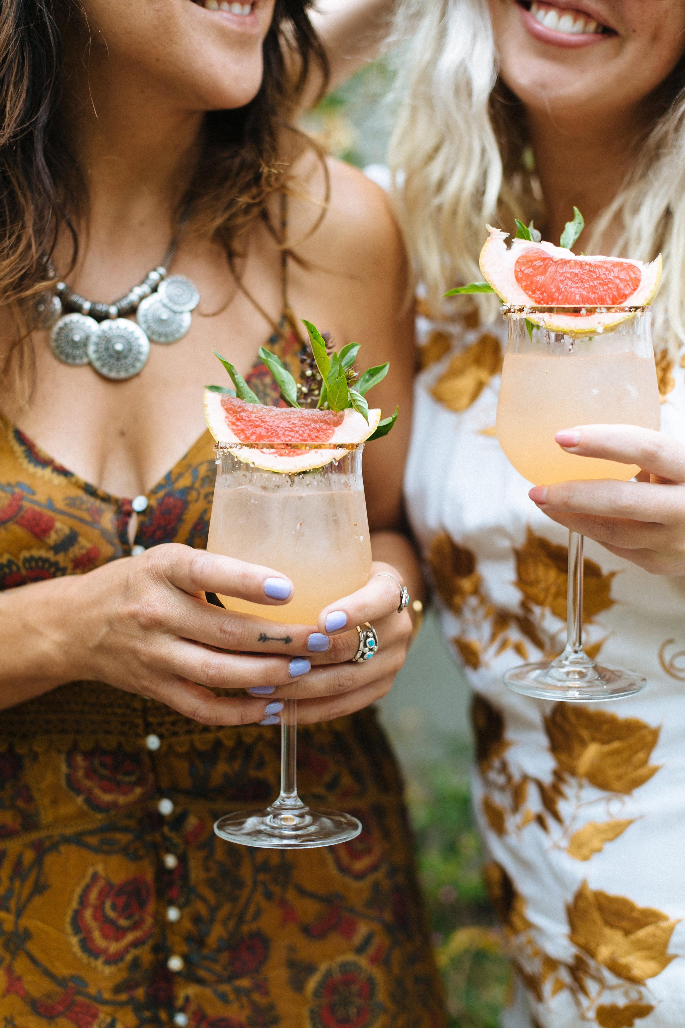 The ladies drinking cocktails with orange slices at Casa Jacaranda.