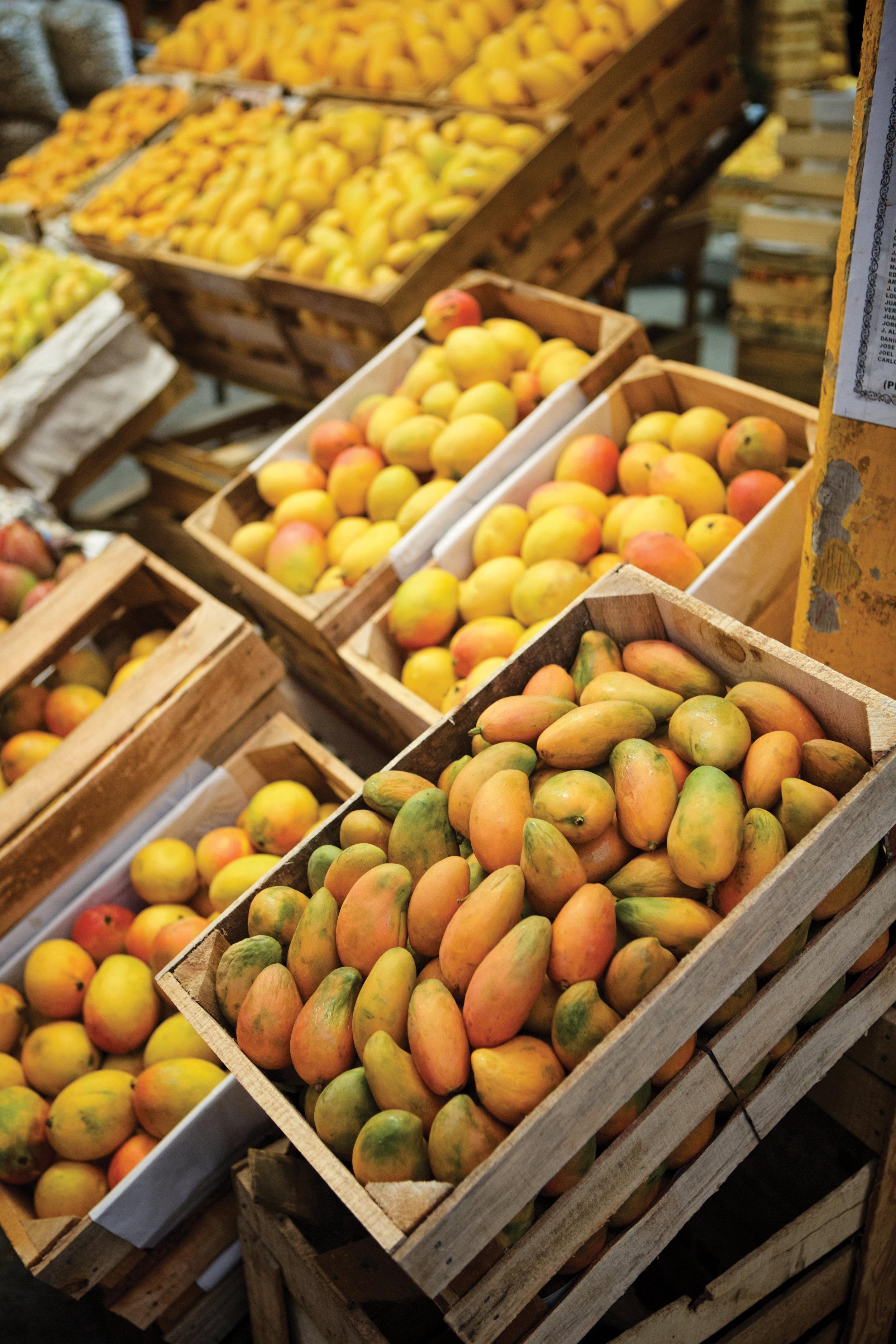 several crates full of mangos