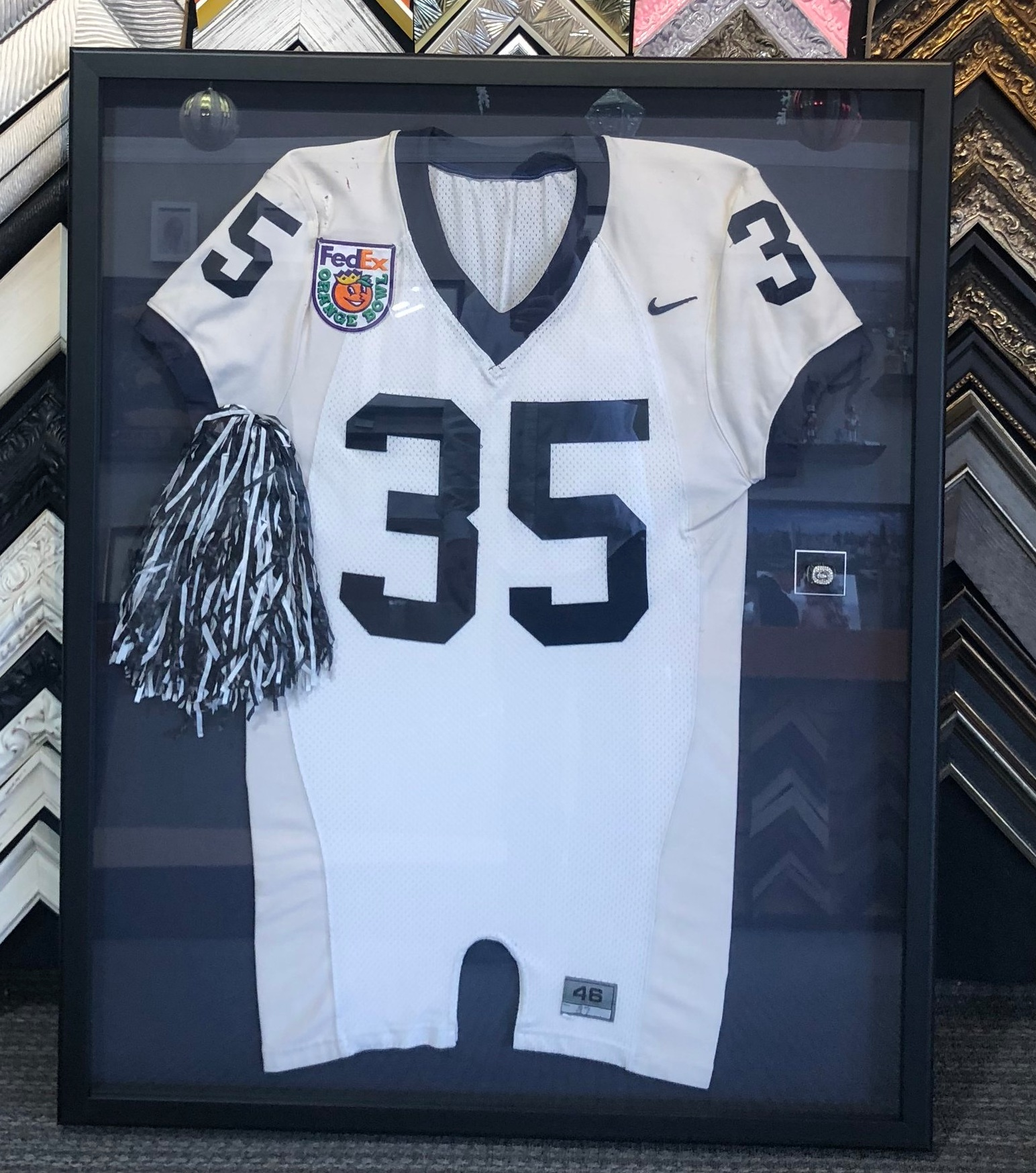 We hand sew all of our jerseys. - Our Focus is to preserve everything we frame. We use archival materials, hand sew fabrics to a mounting board and fabricate custom holders so your collection can be removed. We have more than 36 years of experience. Come in and see why people who win bids at Sotheby's, Christie's and local charities trust our work.