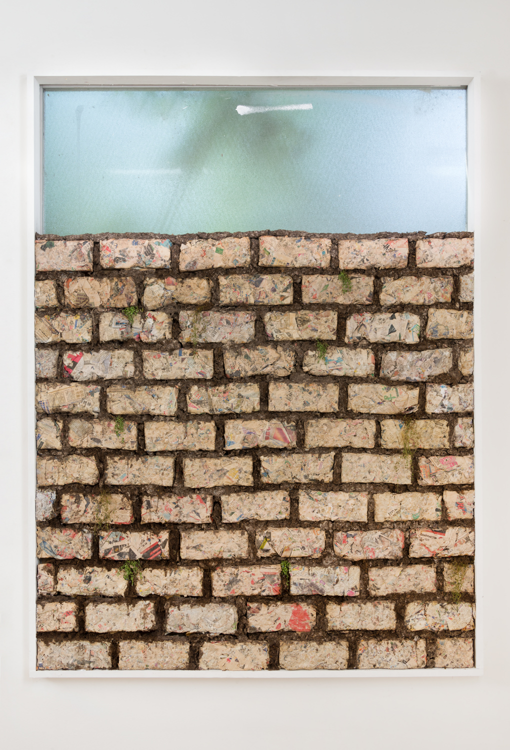 Bea Fremderman  Untitled (Brick Wall) , 2016 paper logs, soil, radish seedling 70 1⁄2 x 53 x 4 in.