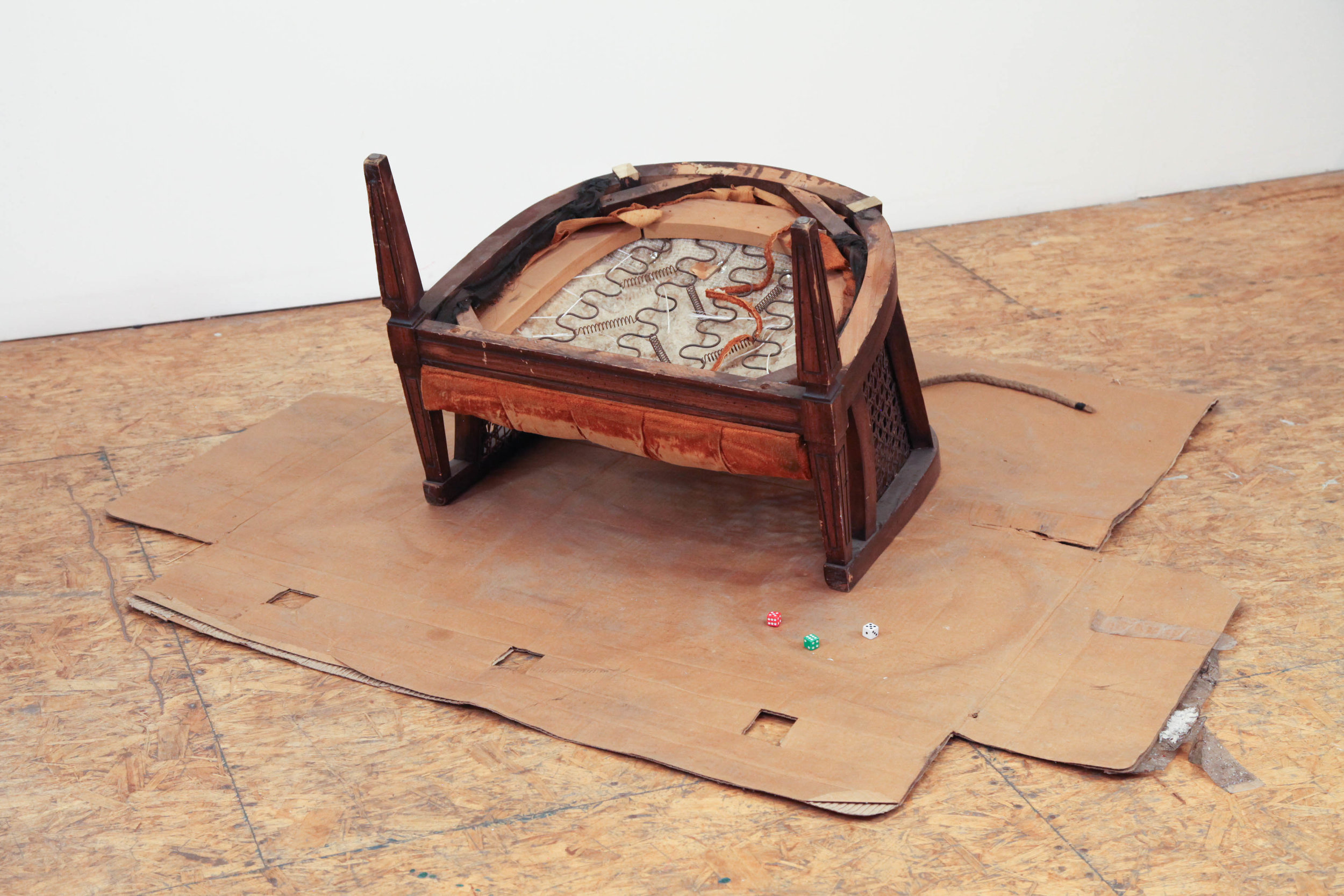 Daniel Gaitor-Lomack  Bull in Space (Ginger Snap), 2017 antique chair, lint roller, cardboard, dice, camouflage mesh fabric, and acrylic paint 23 x 60 x 55 in.