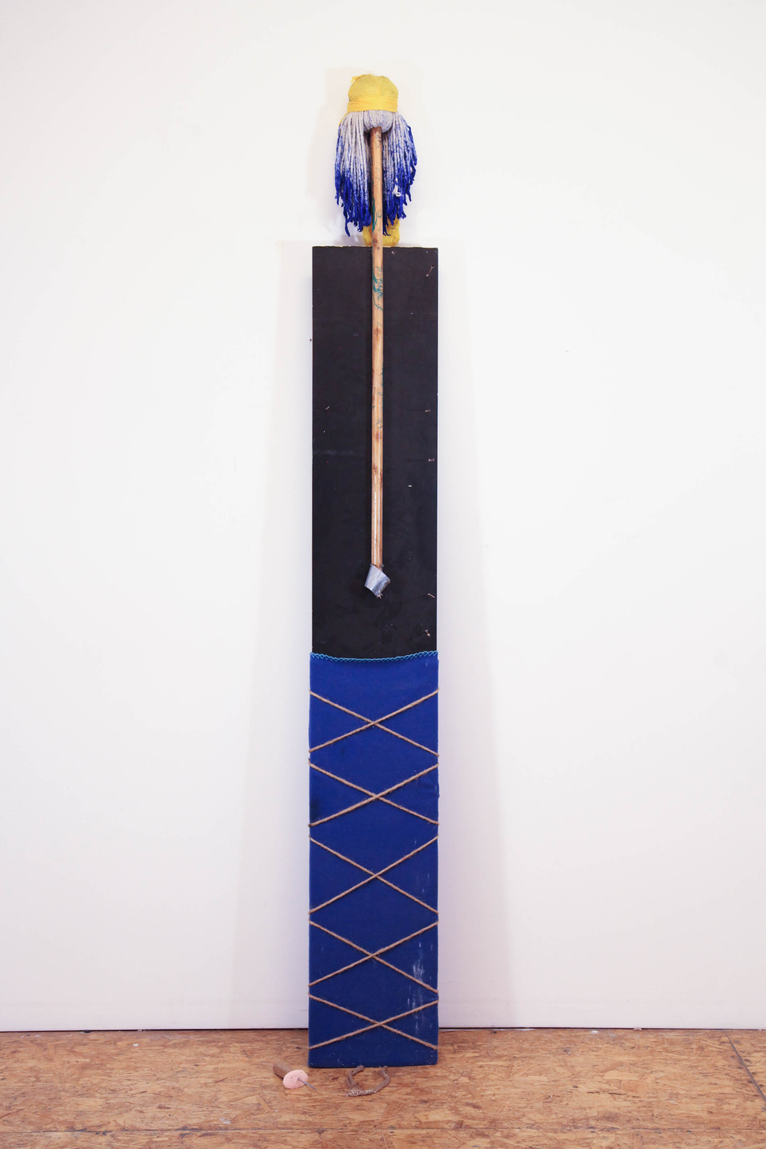 Daniel Gaitor-Lomack  Guardians of the Afro Fantasy (Ice Cold) ,2017 mop head, ice pick, soap, rope, blanket, duck-tape, Bavarian plywood 86 x 12 x 14 in.