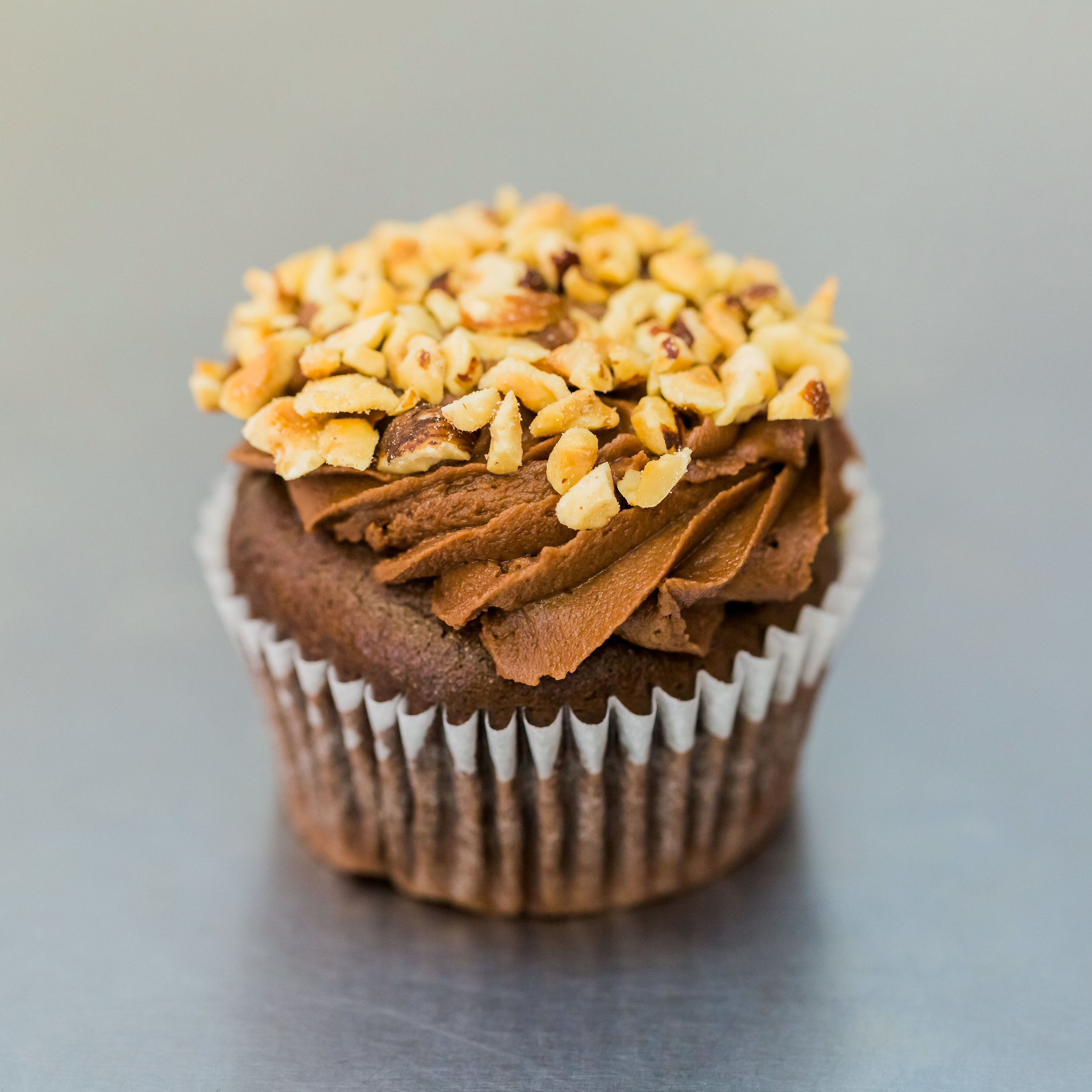 Nutella - Chocolate cake frosted with Nutella buttercream and garnished with chopped hazelnuts