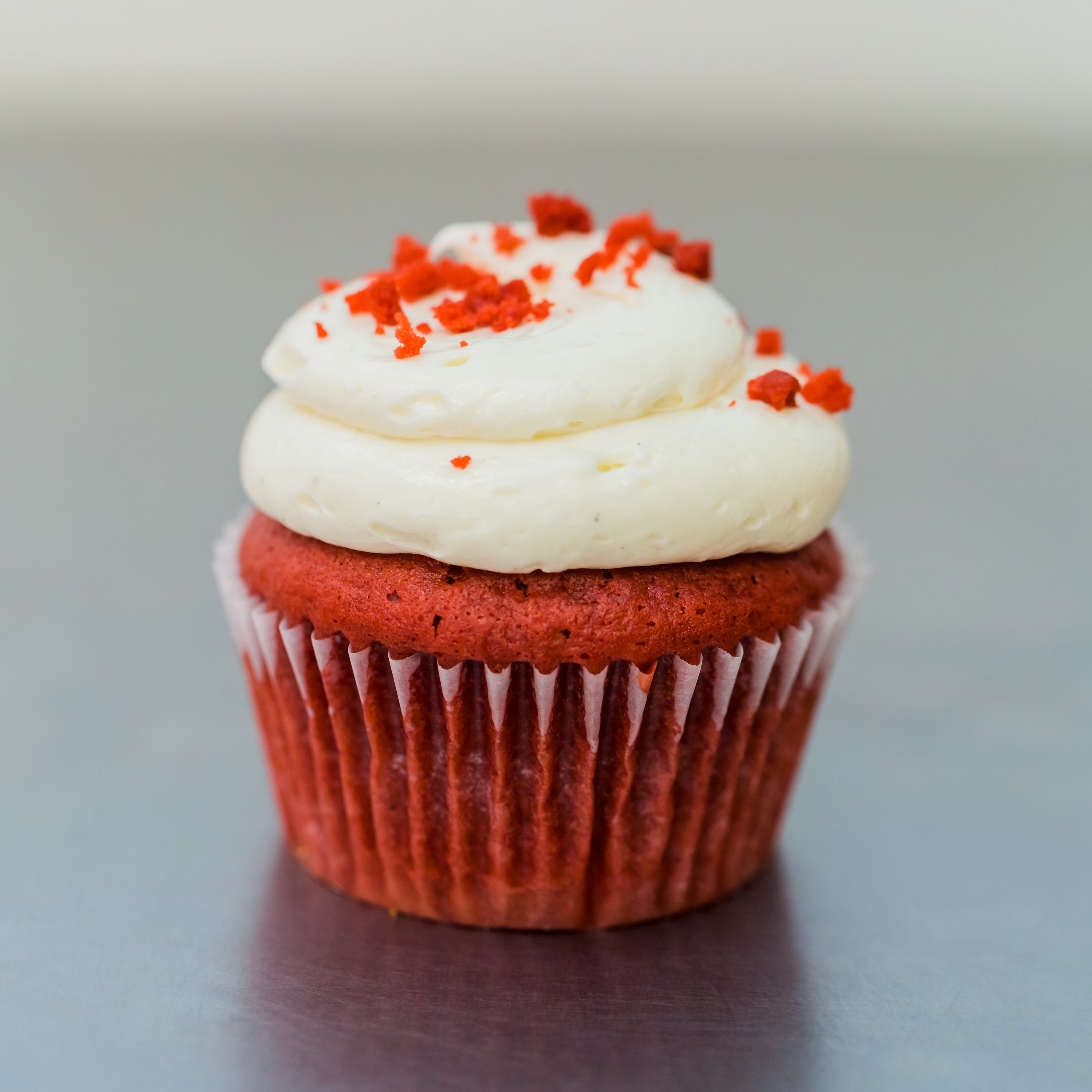 Red Velvet - Red velvet cake filled with a cream cheese frosting, frosted with vanilla bean buttercream and garnished with red velvet crumbs