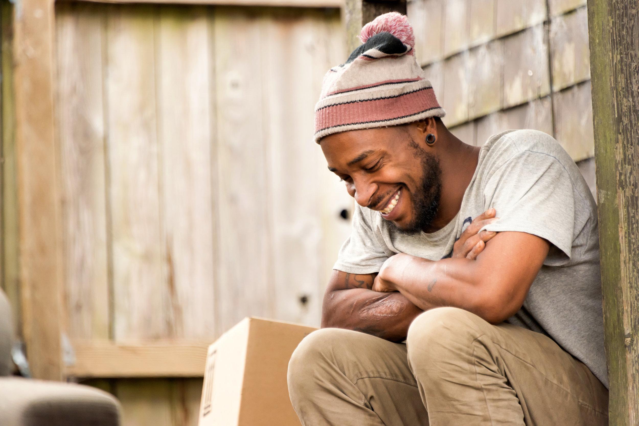 Smiling-afro-caribbean-young-man-811600580_7360x4912.jpeg
