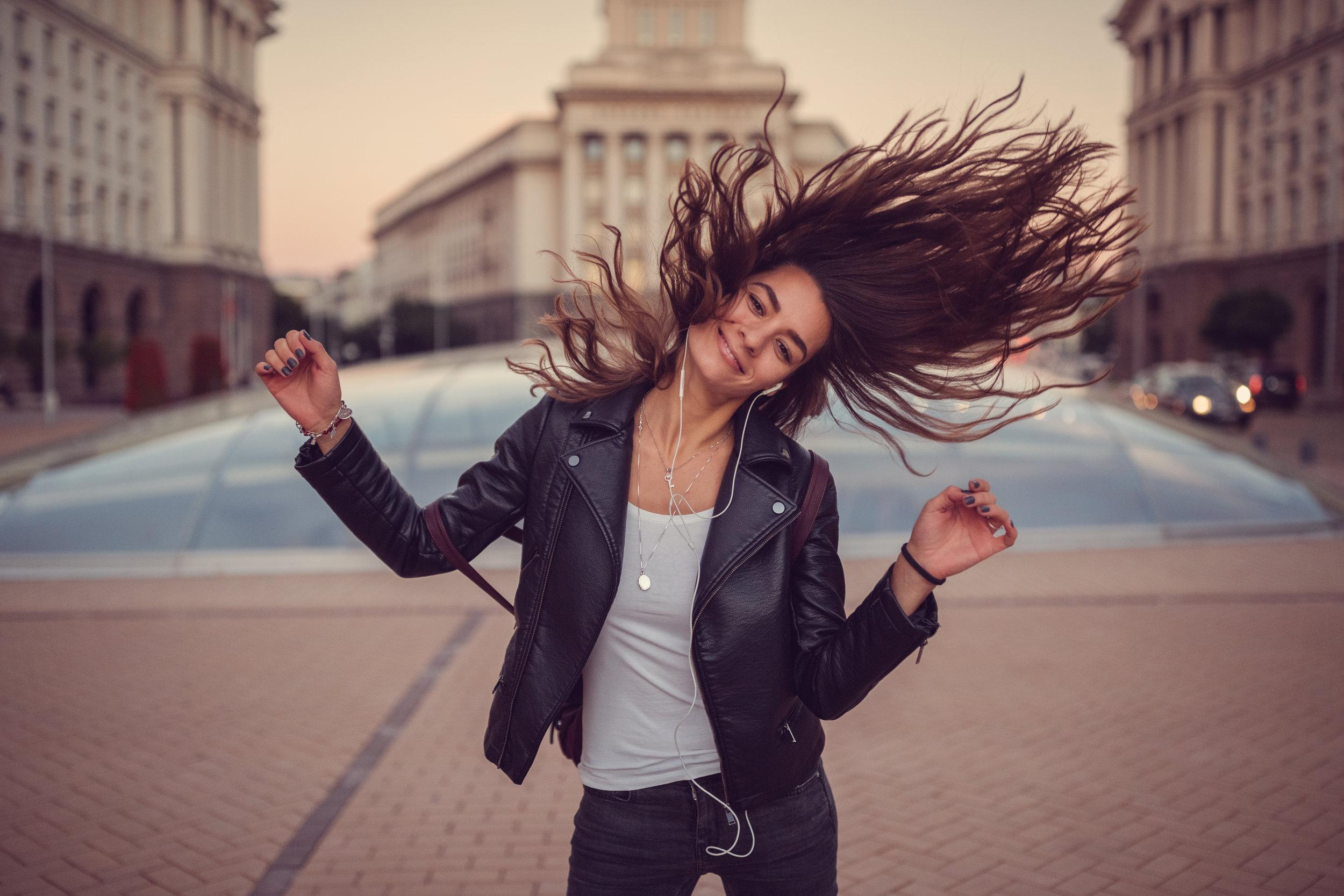 Girl-enjoying-the-music-638140468_5420x3613.jpeg
