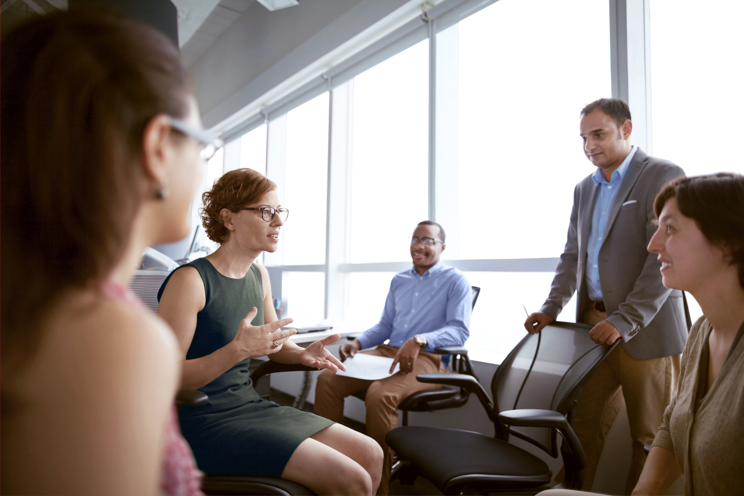 Mature-woman-talking-with-business-colleagues-in-office-637903914_5616x3744 (1).jpeg