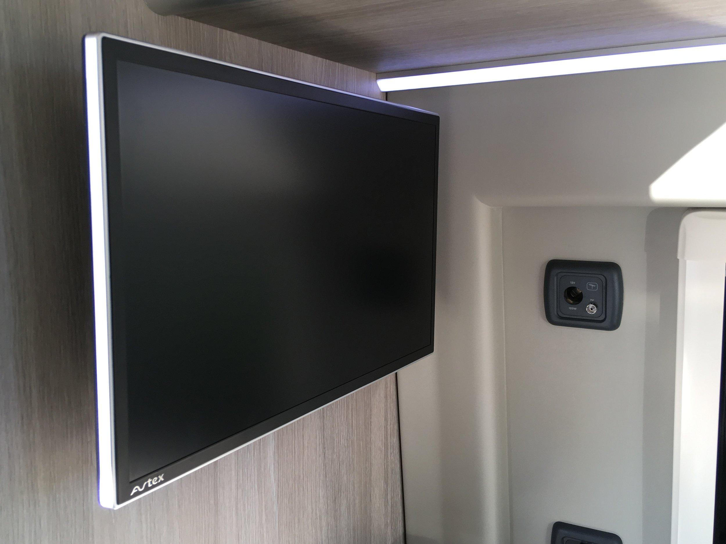 TV on lockable wall bracket