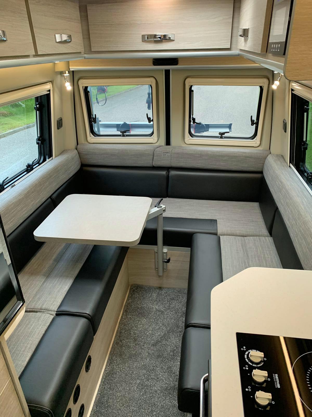 Rebel U-shaped lounge with pivot table