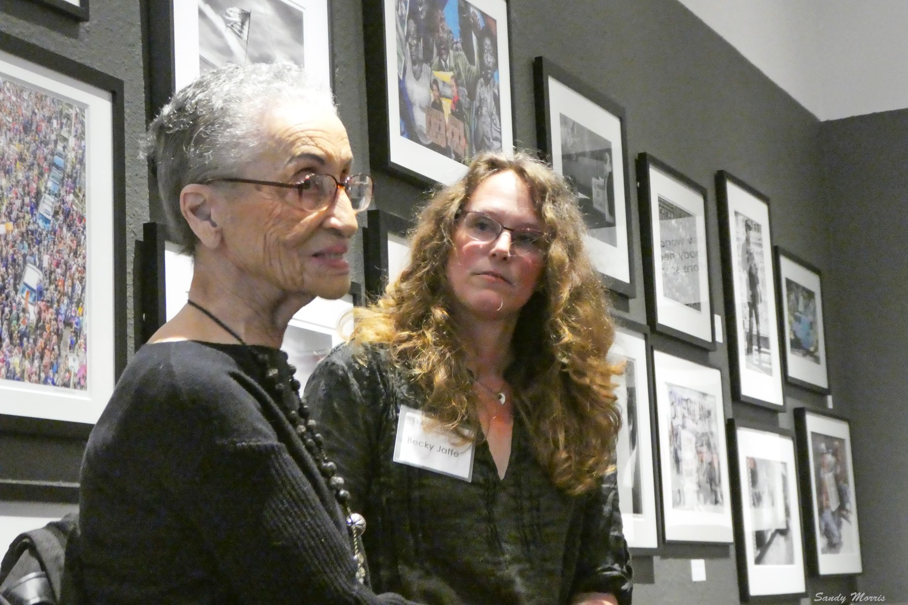 Becky Jaffe listening to civil rights activist Betty Reid Soskin, author of Sign My Name to Freedom, at the Visions of Democracy exhibit at the Abrams Claghorn Gallery. Photo by Sandy Morris