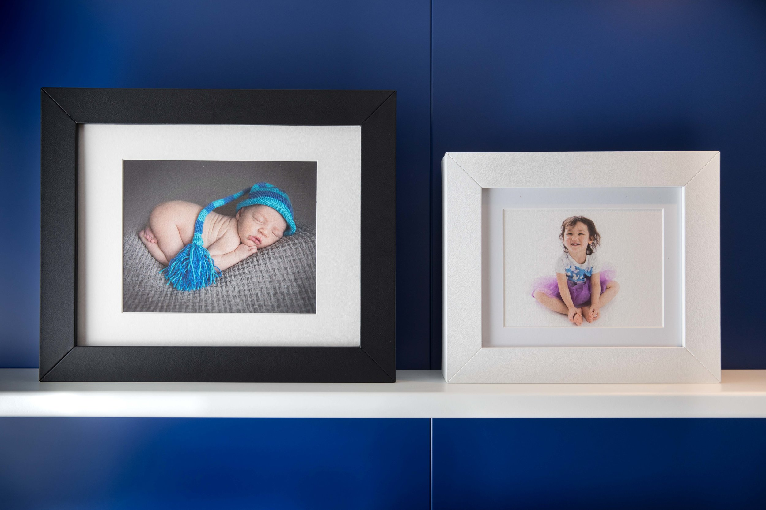 Italian leather heirloom reveal box has a clear lid that frames your images. Rotate them as often as you like to display a different photo.