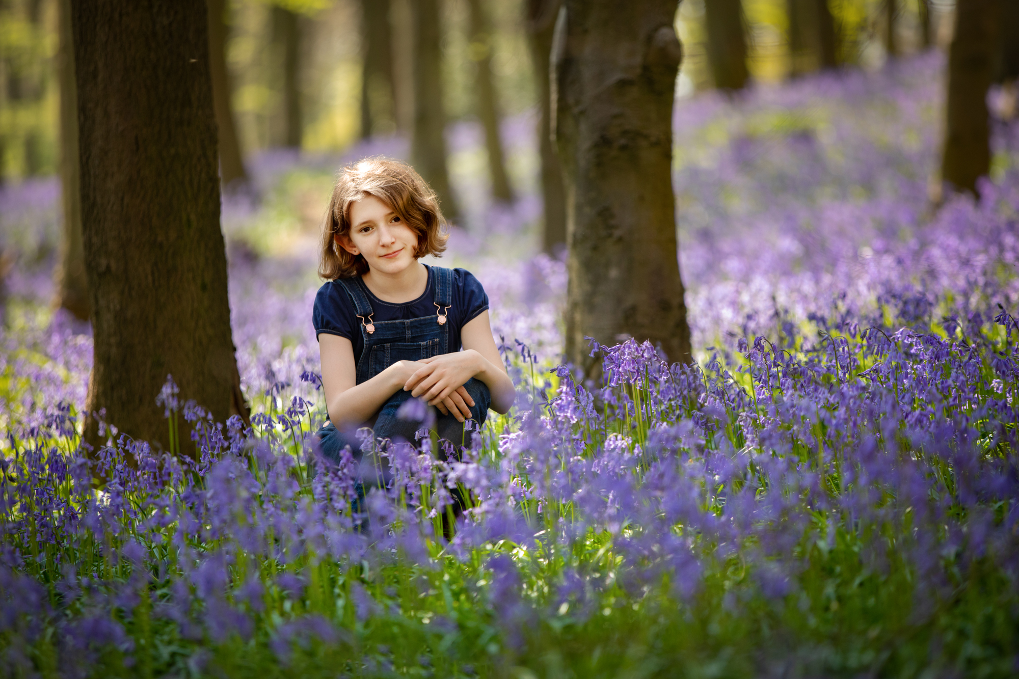 Amongst the bluebells in Shoreham, Kent. I love the serenity of this photo - such peacefulness and solitary amongst the sea of bluebells in a woody forest. This image was shot at 1/500 sec, f/2.8, ISO 320 at 200mm. It wasn't the ideal time with the sun directly above but we were able to find some shade and minimise the dappled light of the woods.