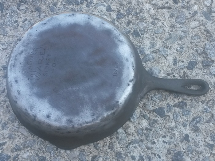 Cast-Iron-Pan-Cleaning-Progress-Wirebrush.jpg
