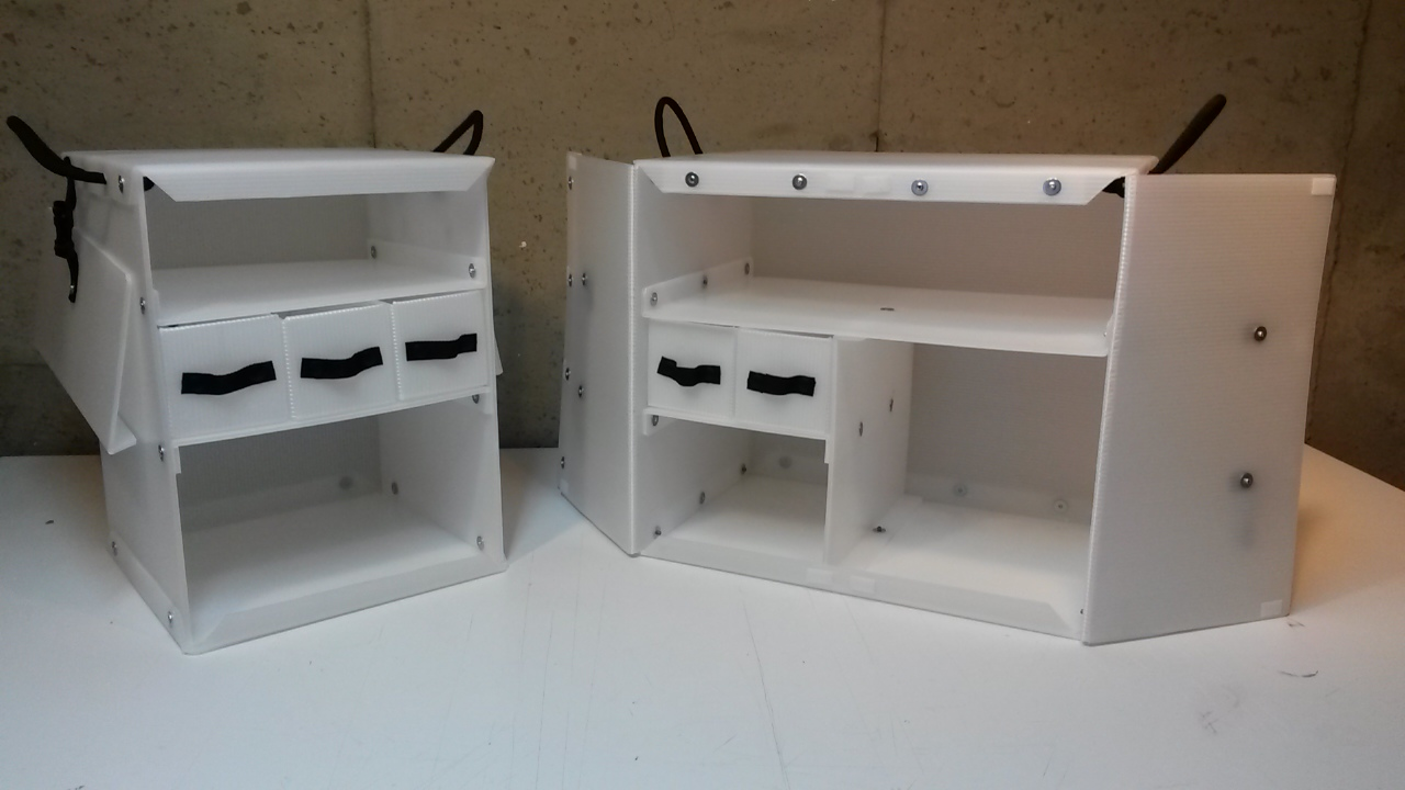 The new Camping Kitchen Box 650 on the left, and our traditional chuck box on the right.