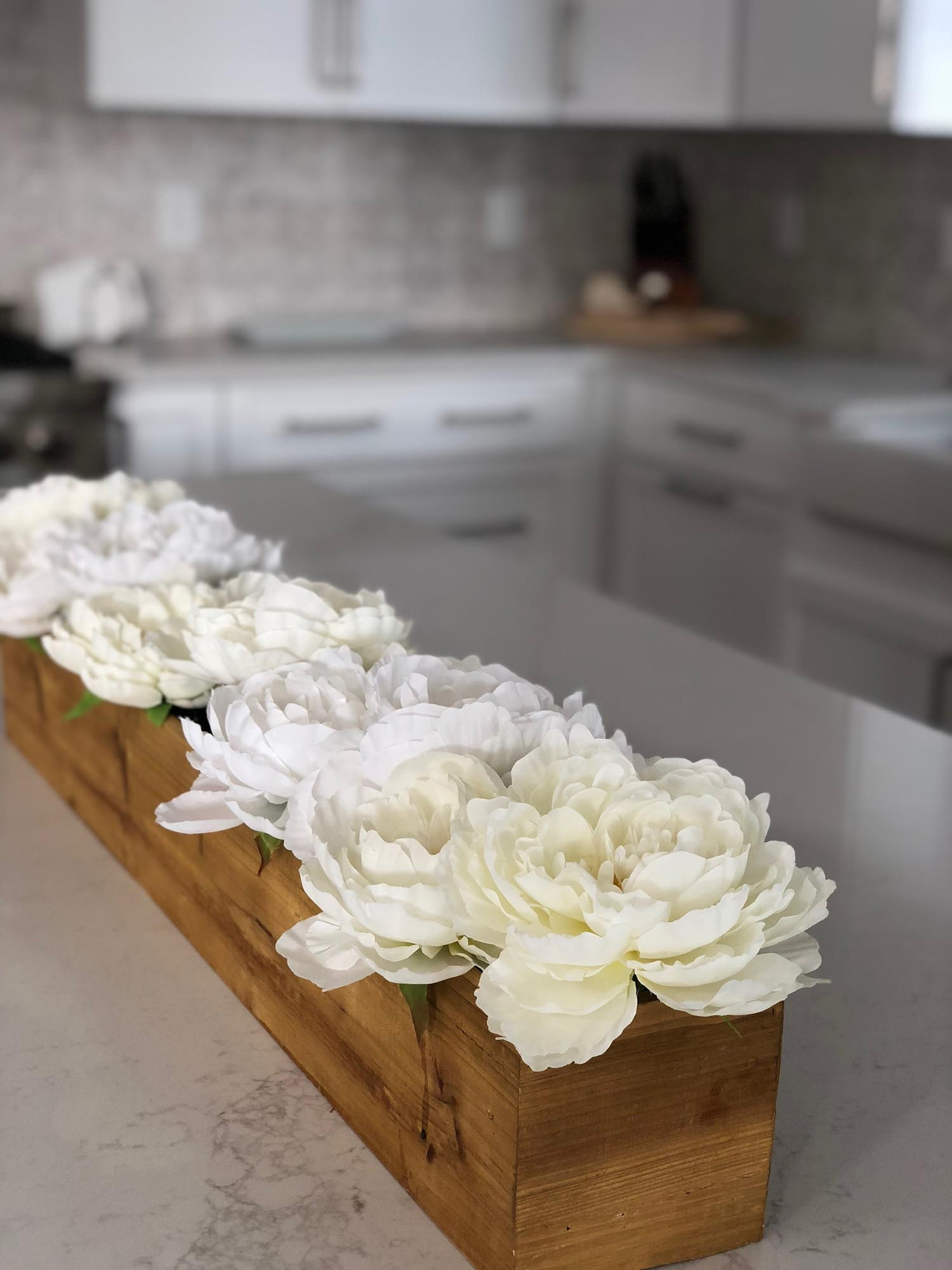White flowers, placed in a long wooden trough