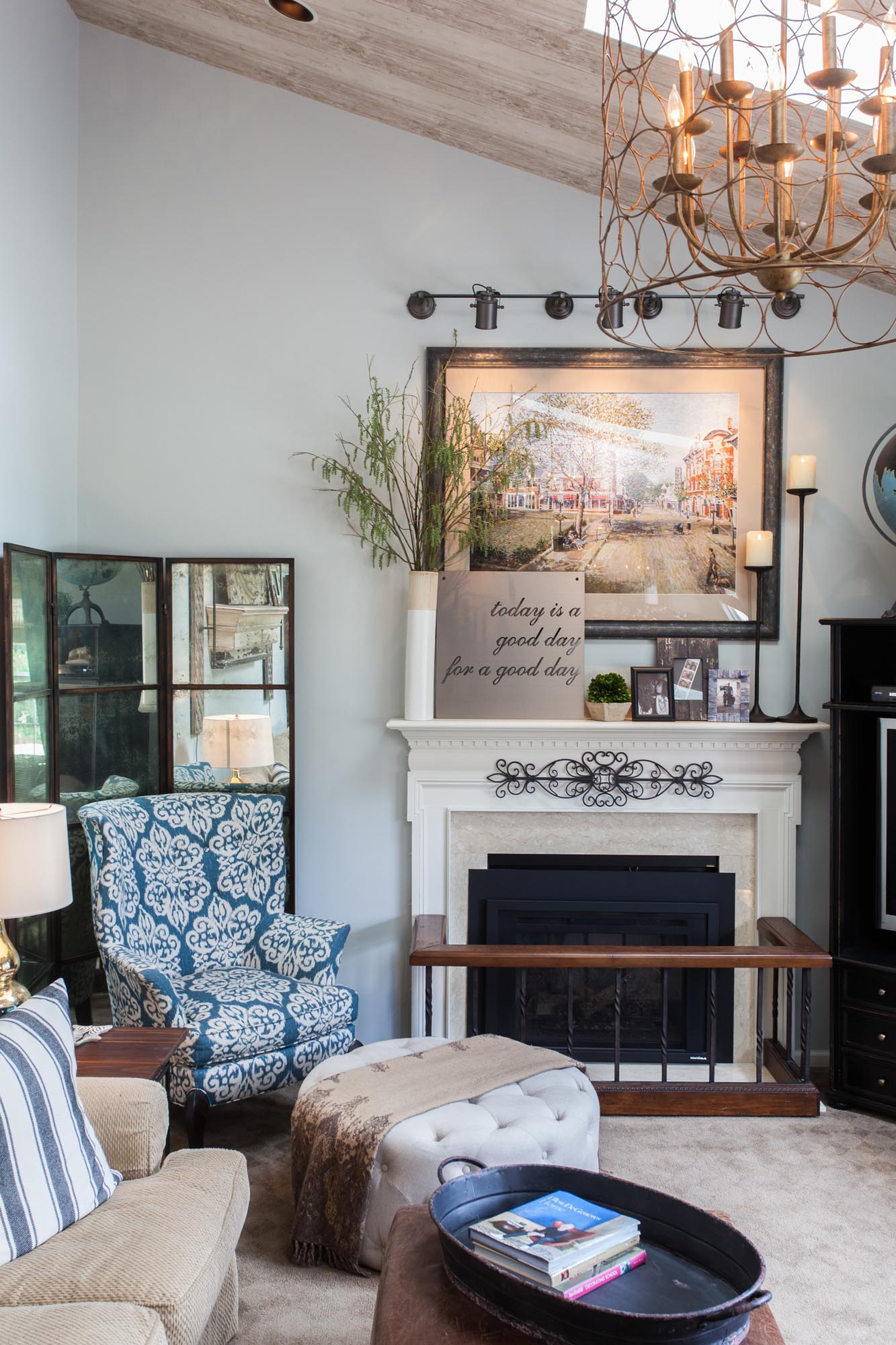 Fireplace with mantle and comfortable seating