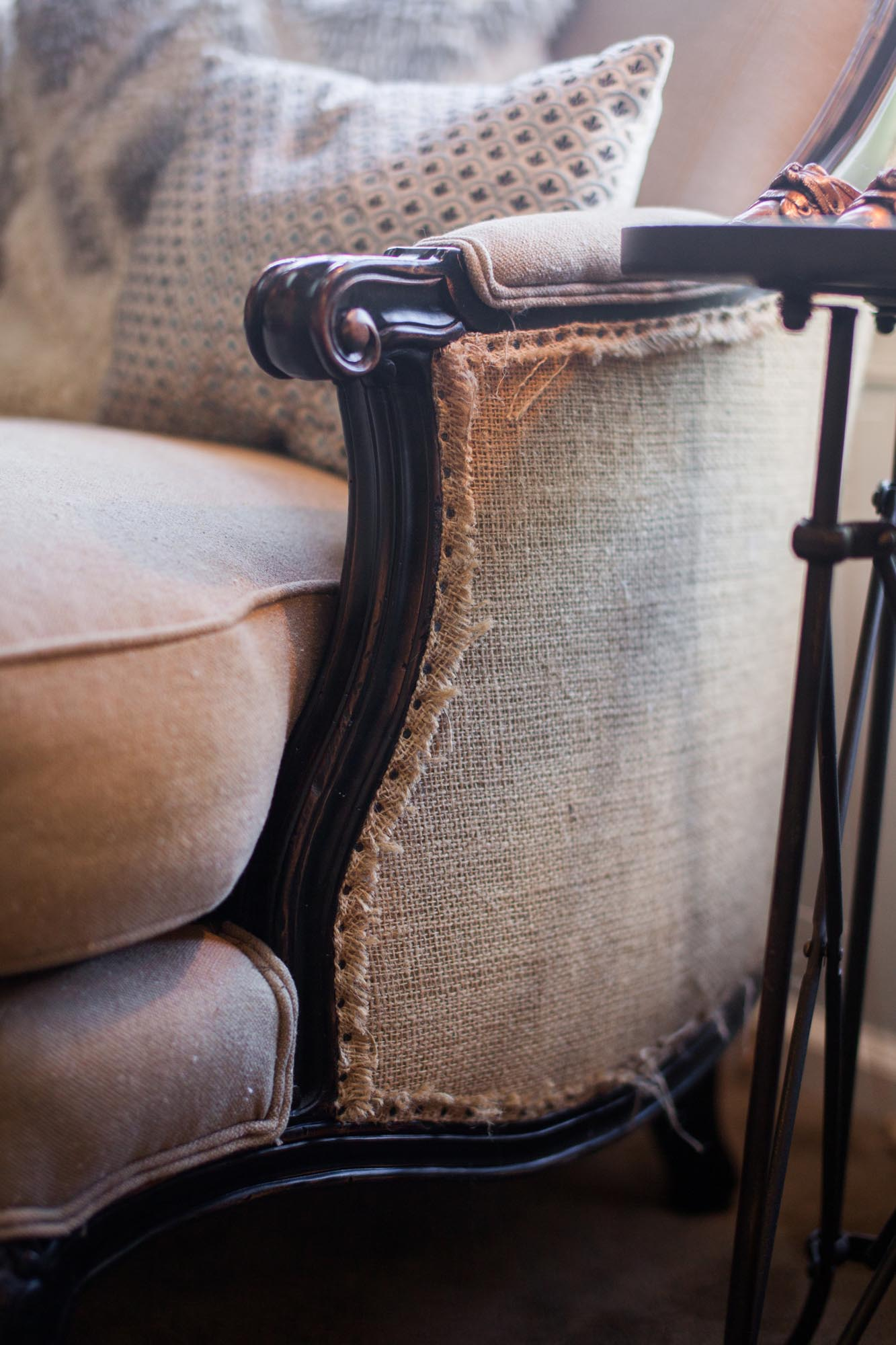 Side of beige colored love seat