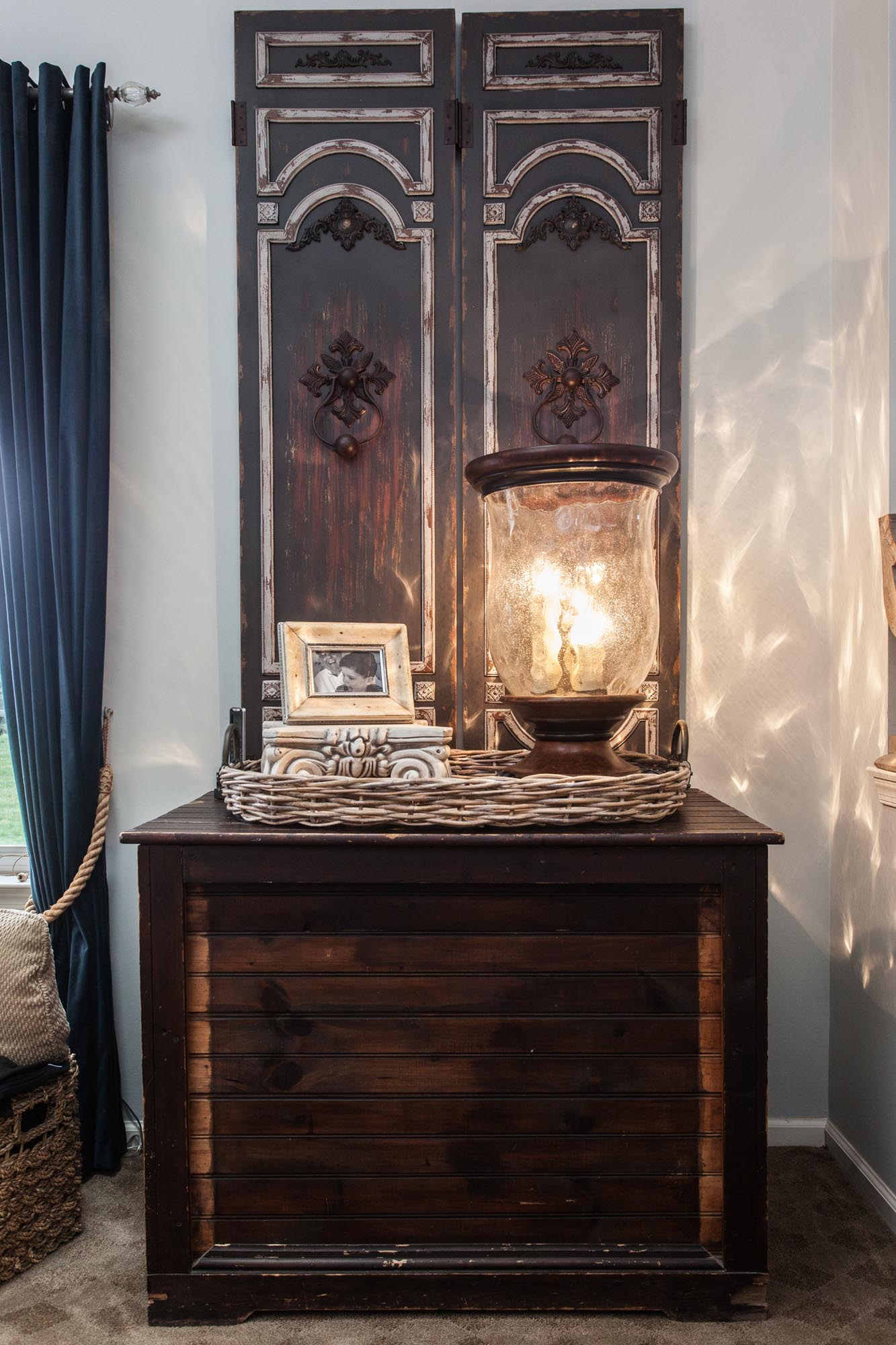 Antique wooden console with wicker basket and gas lamp