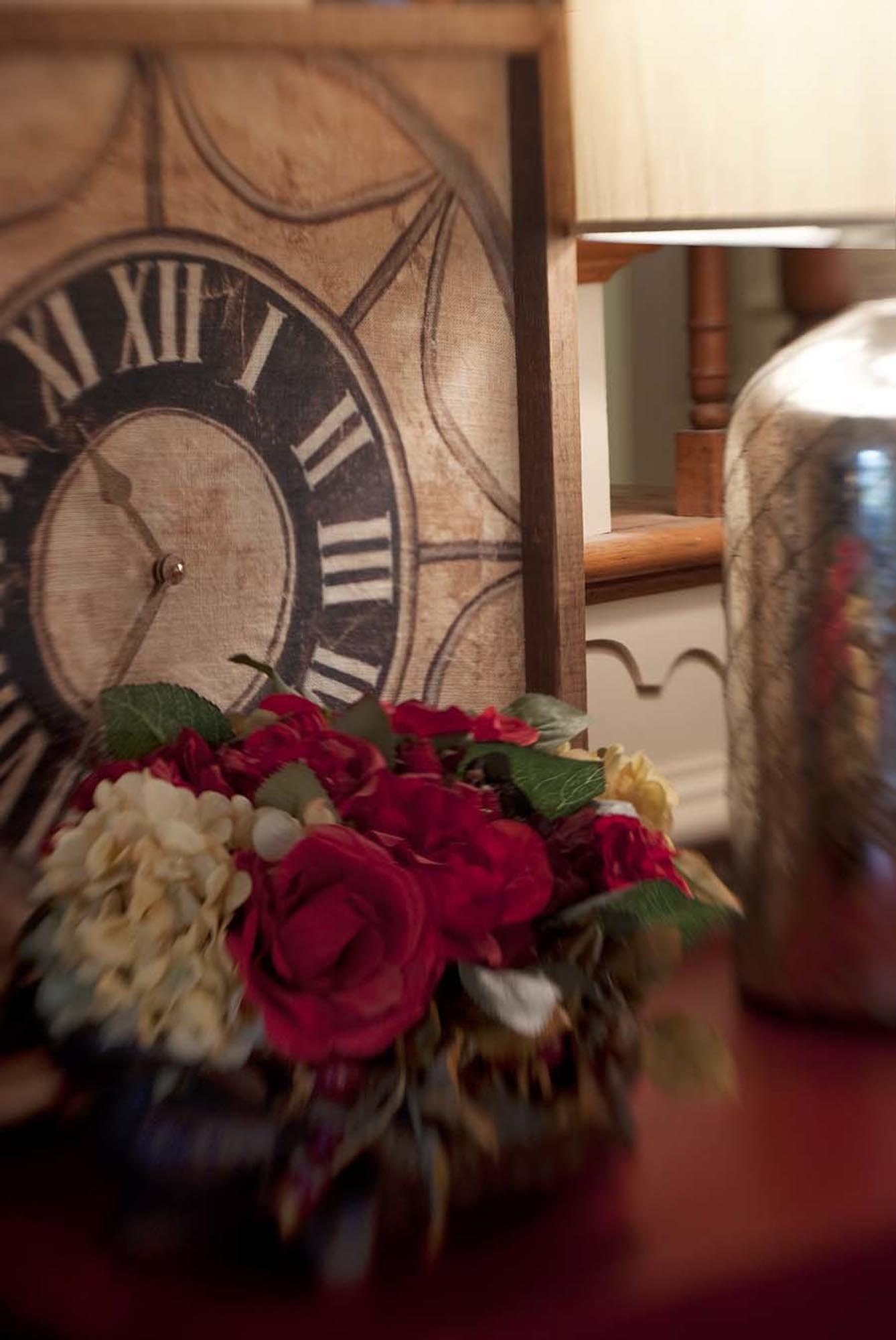 Small bouquet of flowers with retro style clock