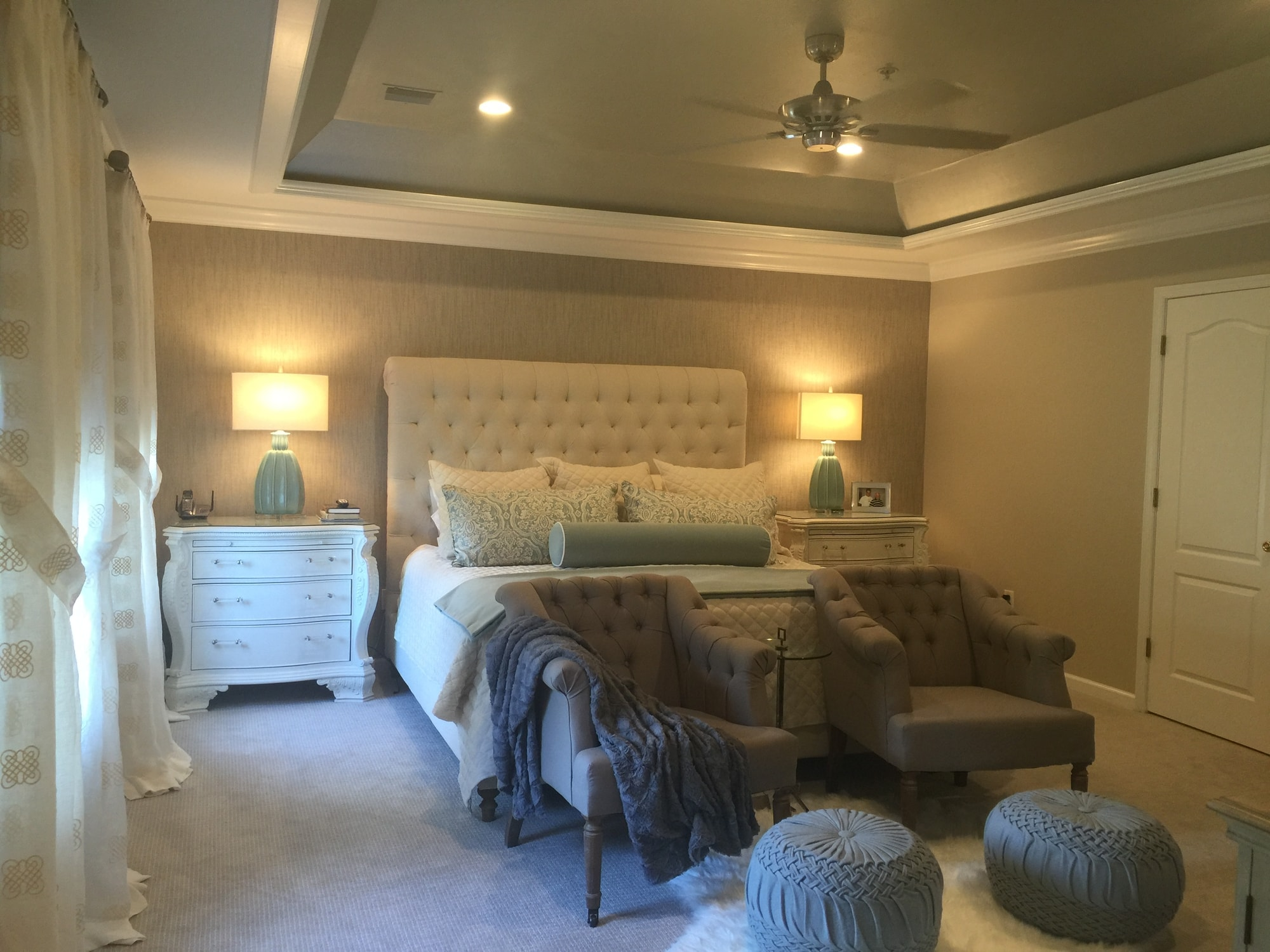 Classic style bedroom with luxury white bed and soft seating chairs