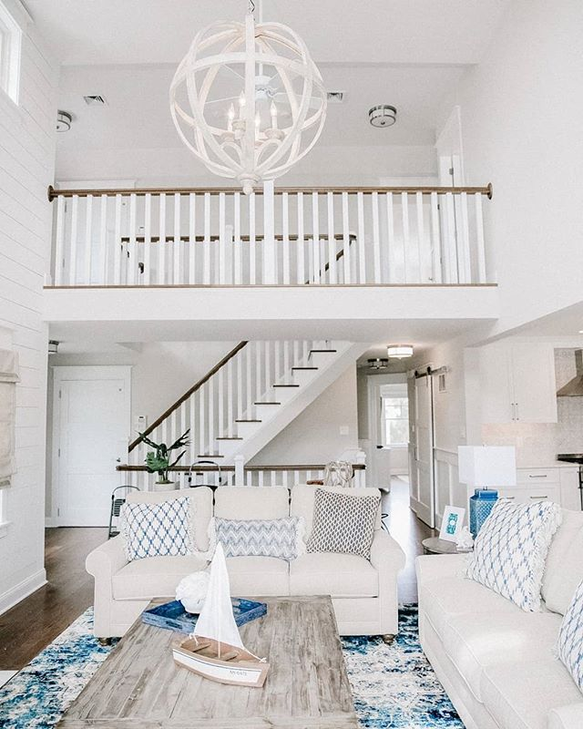 It is hard to believe that this project was a new construction job because the details are just so good! In this double height living room, we warmed up the space while keeping it bright and airy by running gorgeous white plank shiplap up the focal wall, hanging an oversized statement chandelier + using reclaimed wood for the mantel.  As modern and fresh as it turned out, it still feels warm and inviting.  Photo credit @lyndaberryphoto