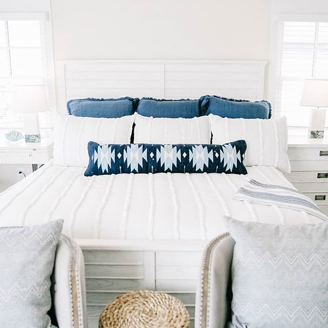I kept this beach house bedroom feeling bright and airy by keeping the palette neutral and bringing in one statement piece. This lumbar pillow is a bold statement, but easy to update over the years as the home owner's style changes! ✨  Do you guys want to see an affordable pillow round up?