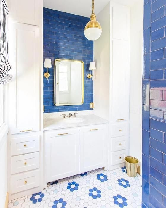 I stumbled across this bright bathroom design on Pinterest + fell completely in love with the bold tile! It's easy to play it safe with all-white bathrooms, but a bathroom is one of the best places to go bold!  Stick with a simple color palette (2 colors or less) to keep it timeless + let the tile do the talking!  Design: Mercury Mosaics