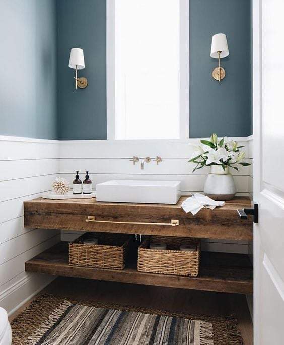Speaking of bathrooms... this reclaimed floating vanity is the perfect marriage of rustic and modern.  It also has me thinking - could you do a window instead of a mirror in a powder room?  Tell me in the comments - Yes or No!  Design: @timbertrailshomes Photography: @stofferphotography