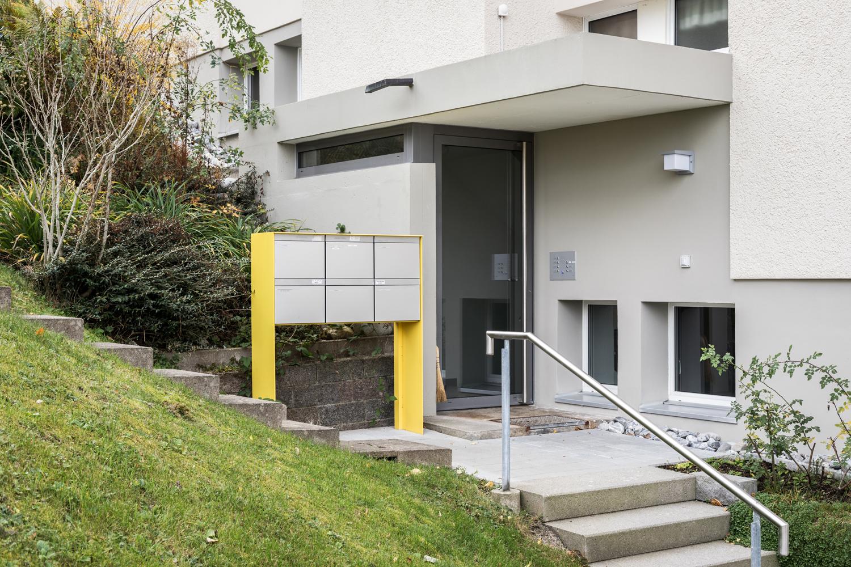 Mehrfamilienhaus-sanierung_Balkon-Fassade-Dreilindenhang-st-gallen_eingang-treppe.jpg