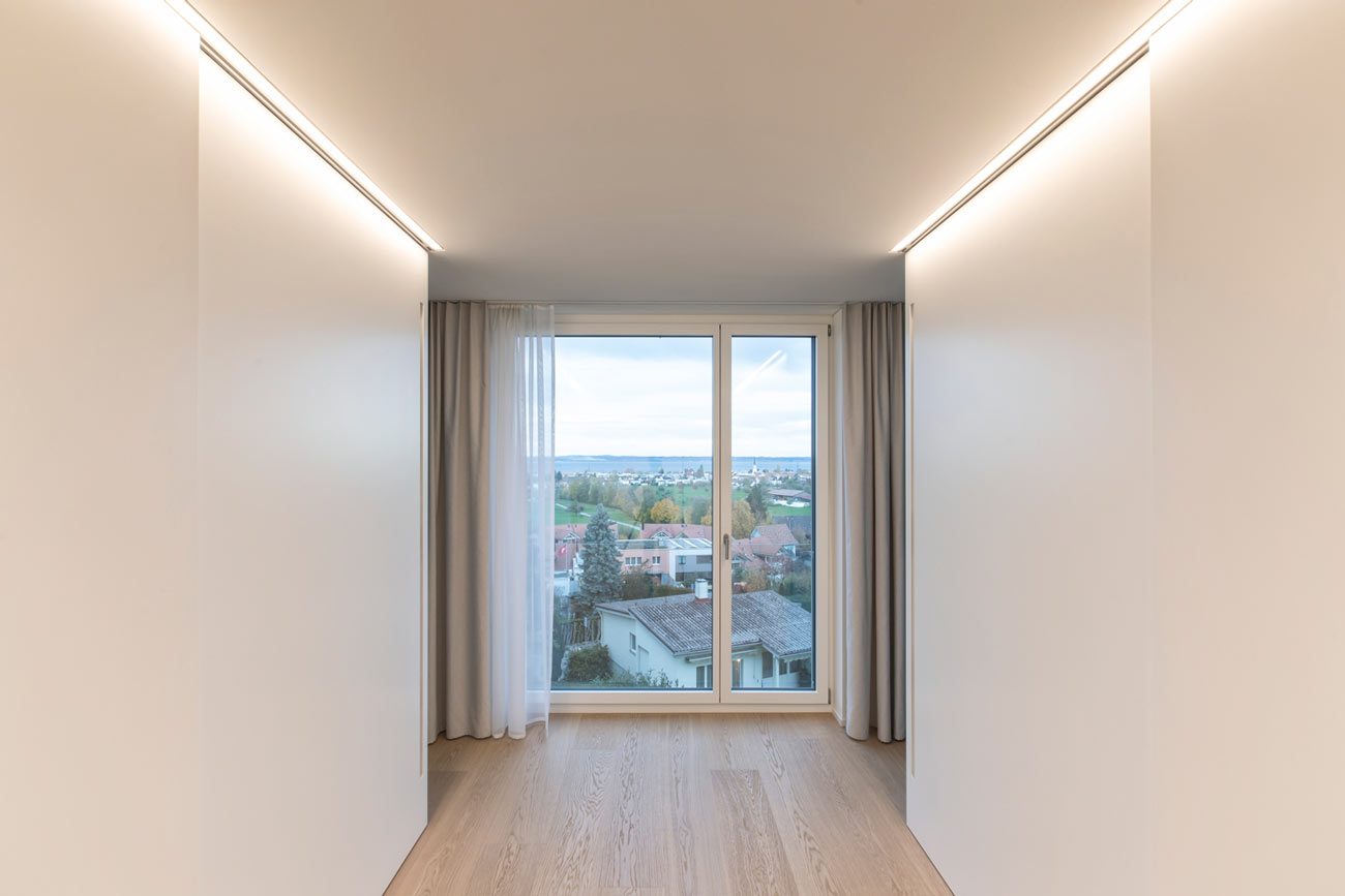 Neubau-Mehrfamilienhaus-Tuebach_Neubrunnstrasse-korridor.jpg