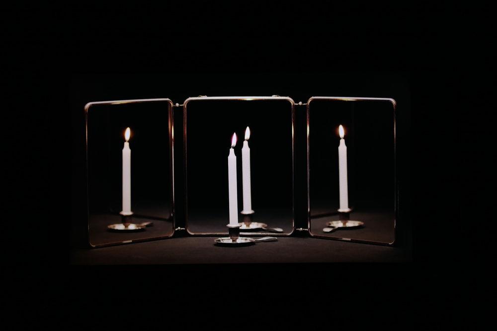 """Heewon Kim,  Someone's Candle , 2015, 4K video, 32"""" display, wooden frame, 67 x 40.5 x 6 cm. Courtesy of the artist & GALLERY SU:."""