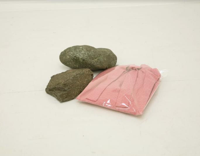 Eri Takayanagi, Clothes and Stones, 2011, Clothes, plastic bag, stones, 10.5 x 42 x 39.5 cm