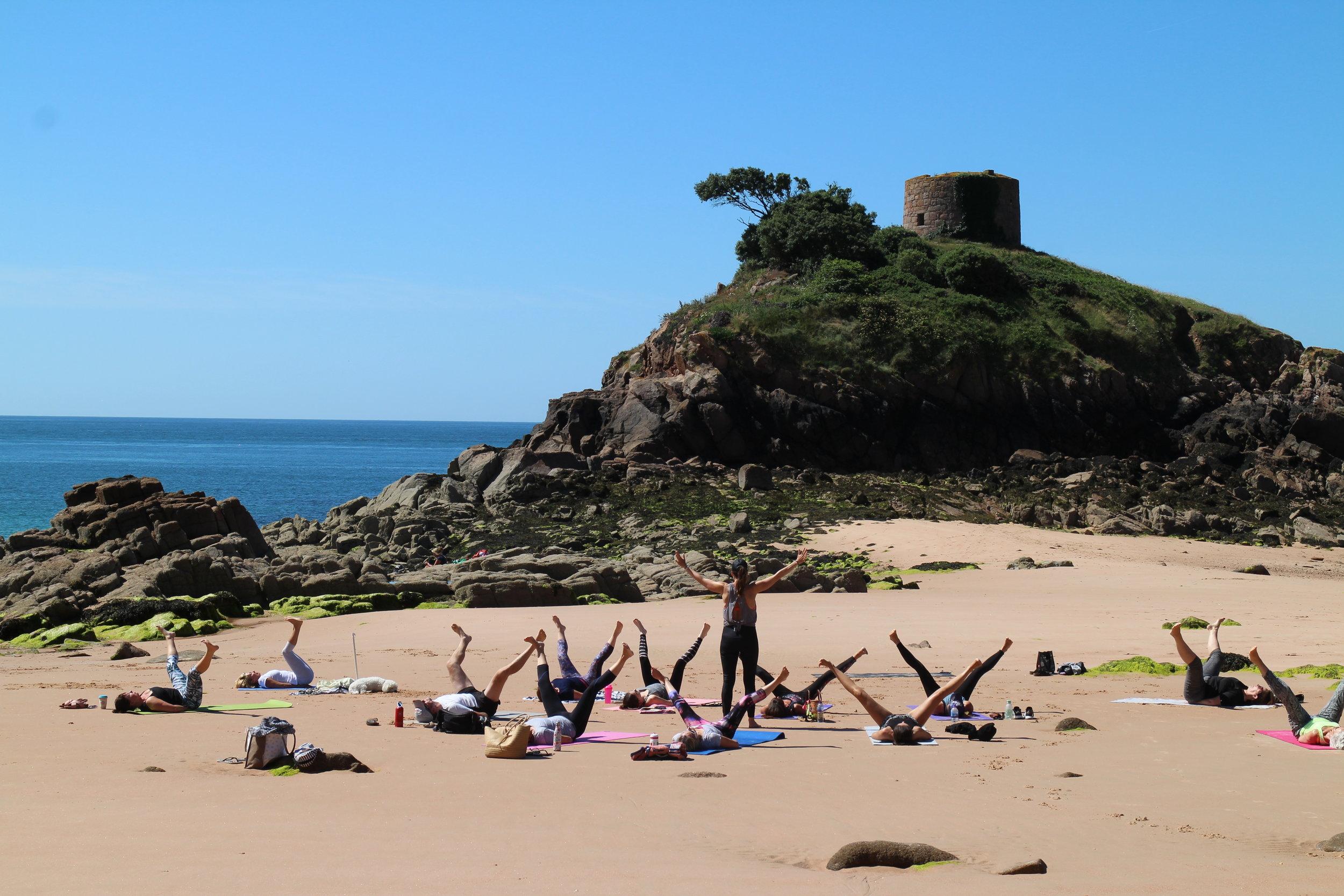 Yoga at beautiful Portelet Bay
