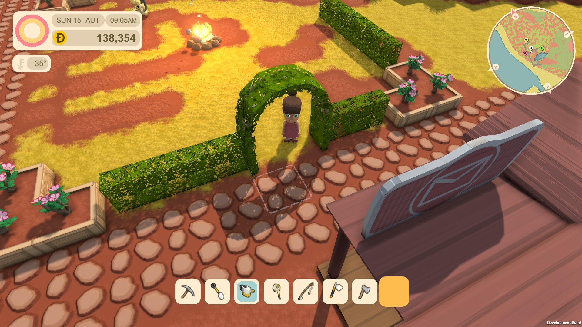 Hedge arch and flowerbeds to decorate your town.