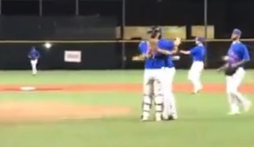 T-Bolts catcher Luke Trainer and pitcher Tyler Dyball embrace after final out of Bolts victory
