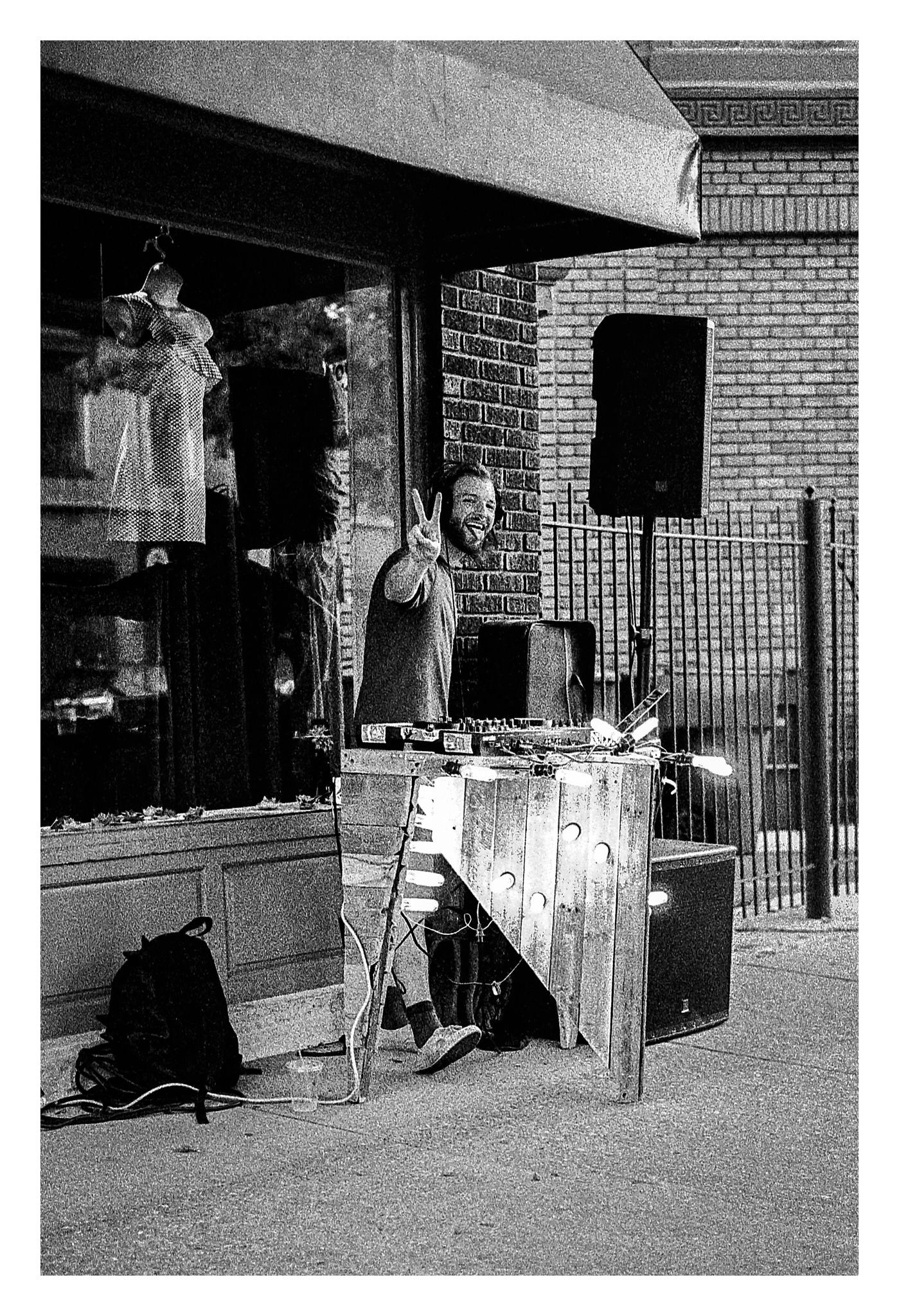 Sidewalk DJ - Nikon F5 with 50mm f/1.4 lens at f/2.8 in A-Priority mode on Kodak TMAX P3200 film