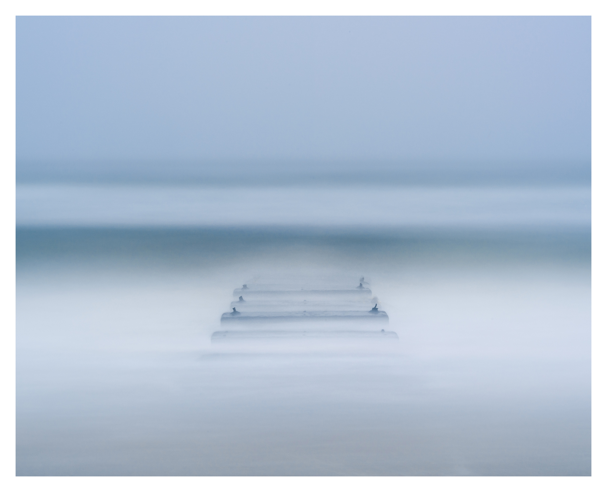 Into the Blue near Nags Head Fishing Pier - Nikon D750 w/80-400mm lens, long exposure with tide coming in.