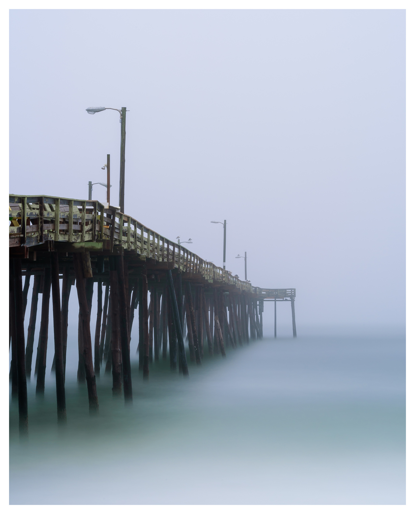 Nags Head Fishing Pier - Nikon D750 w/80-400mm lens, long exposure with tide coming in.